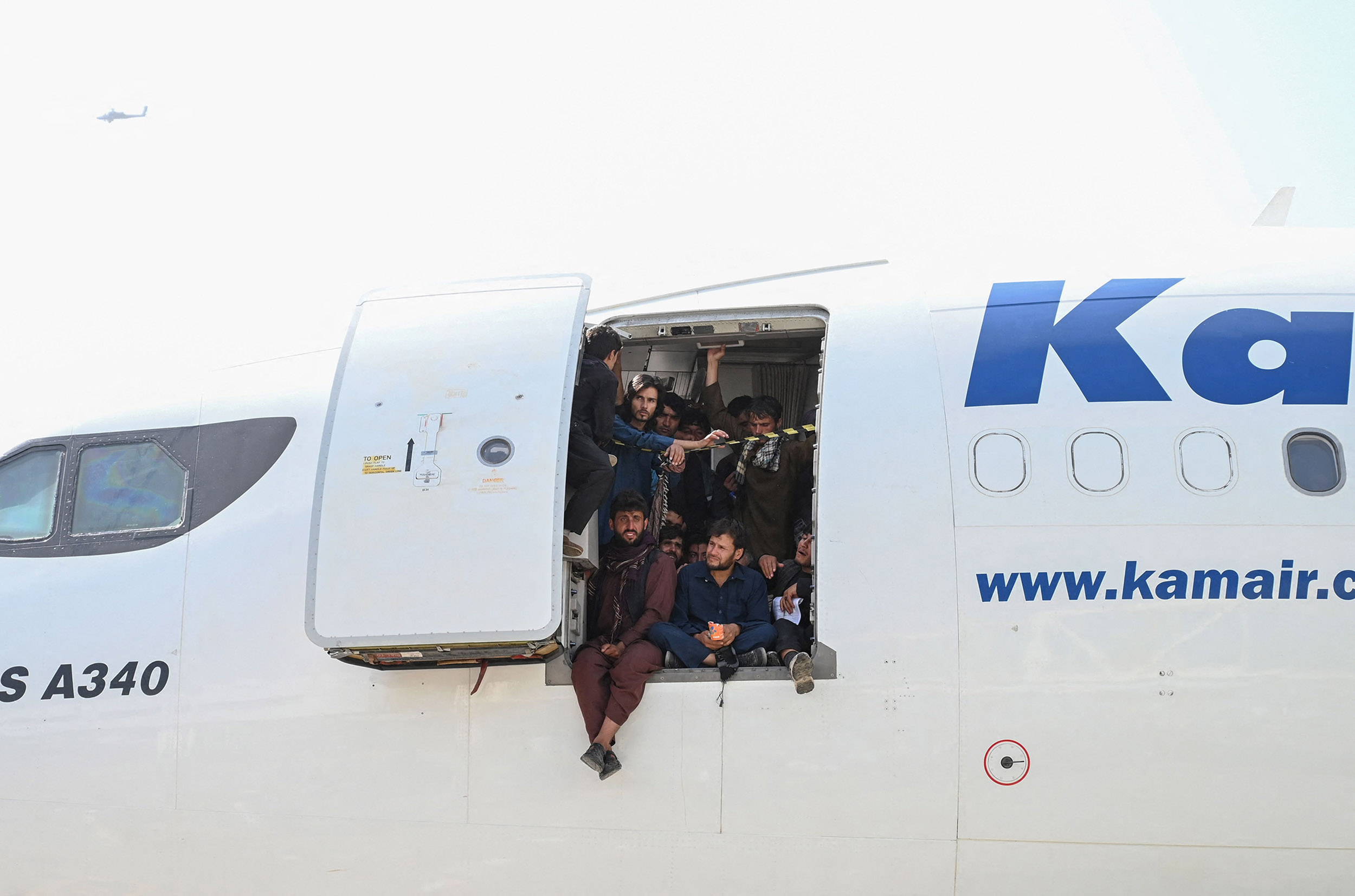 Videos show desperation at Kabul airport as Afghans crowd planes, cling to jets to escape