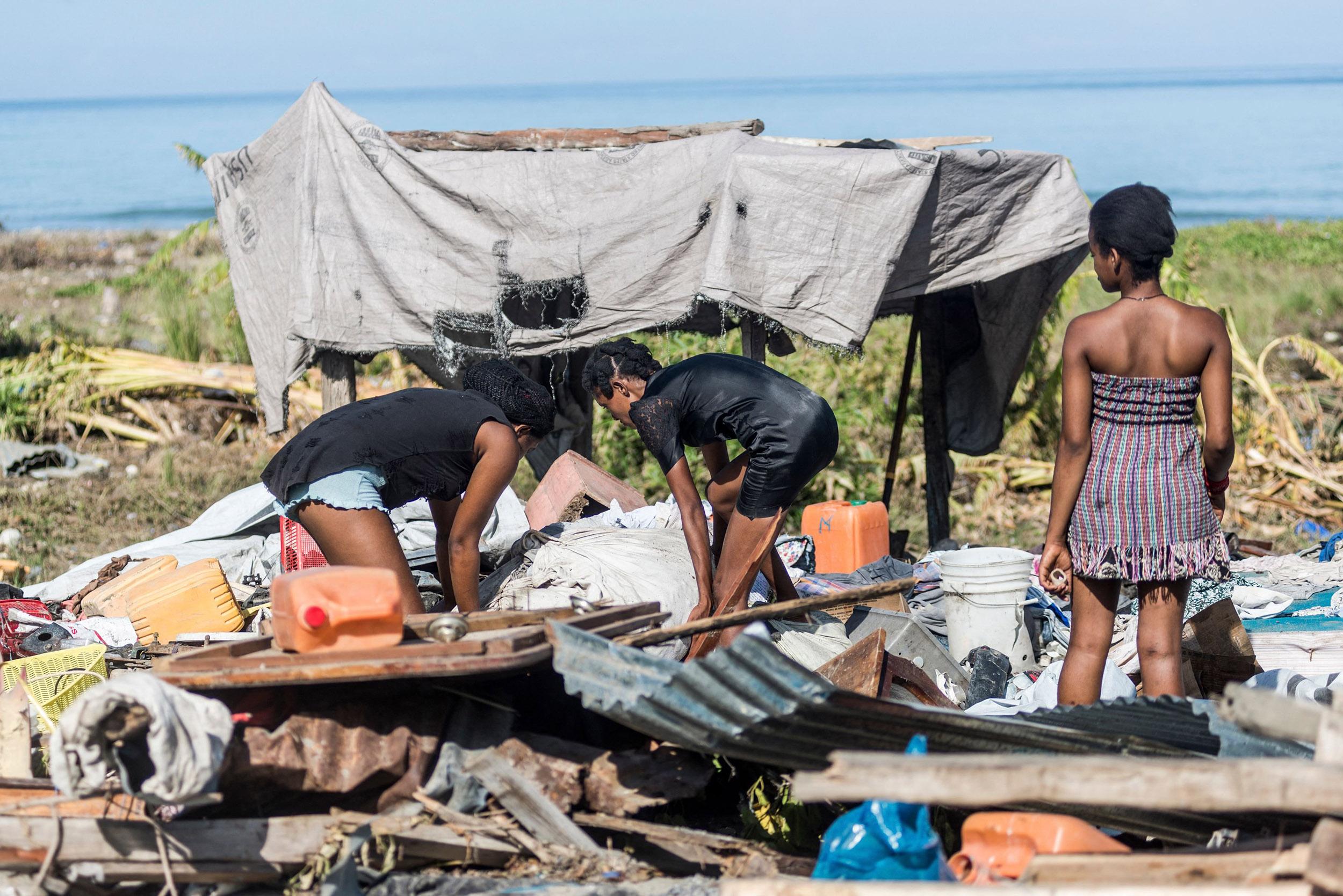 Storm complicates earthquake response as it soaks Haiti
