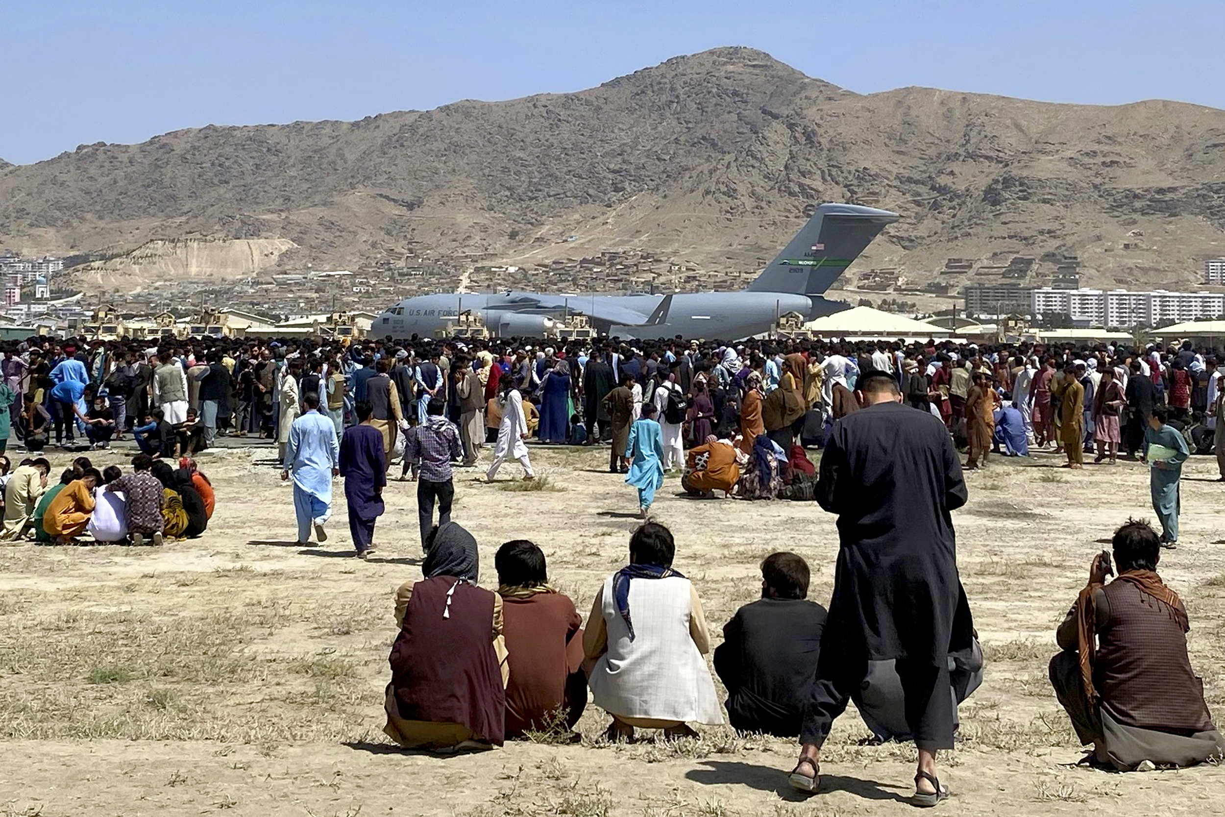 Body found in landing gear of U.S. plane people clung to as it left Kabul