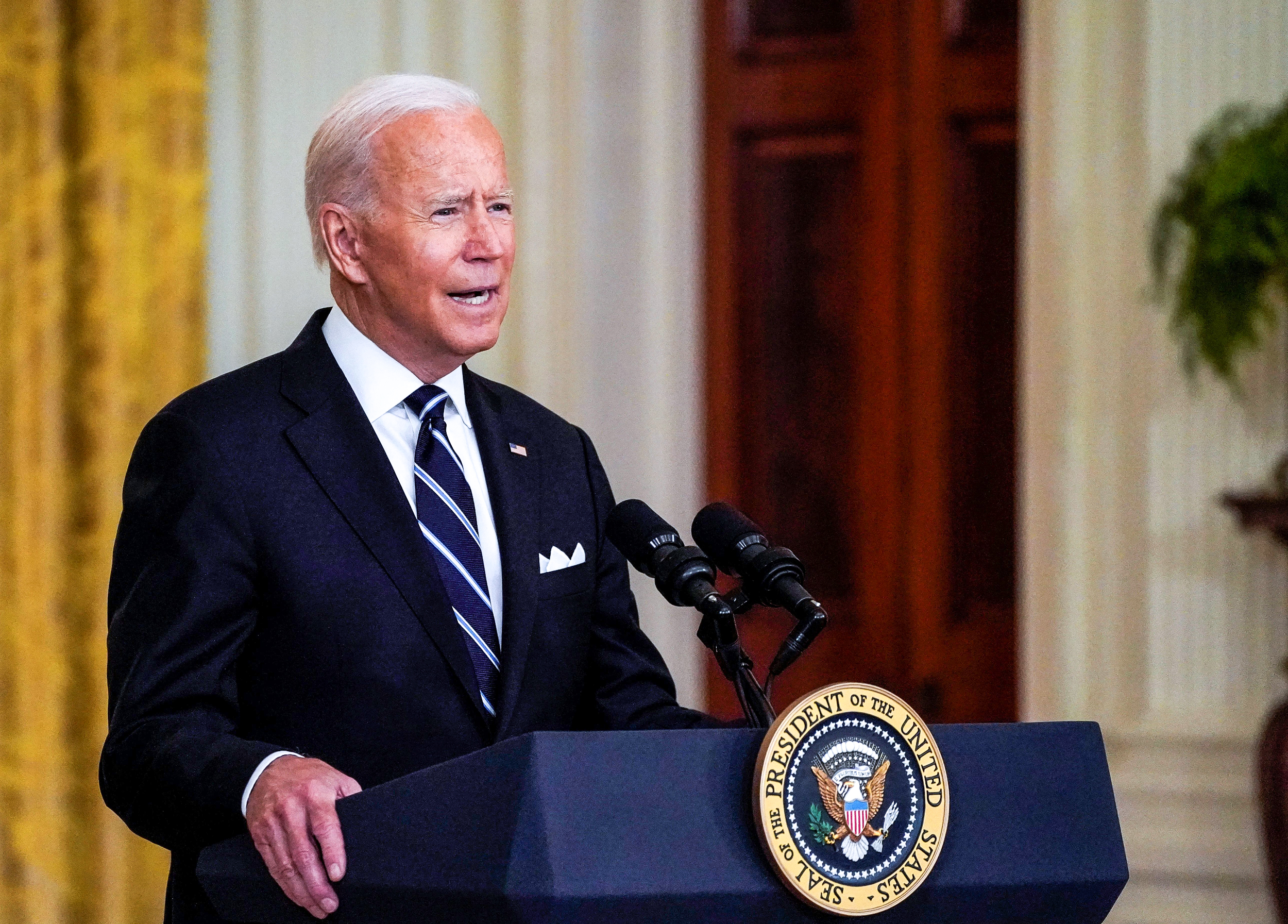 Biden says his administration will take on GOP governors blocking masks in schools