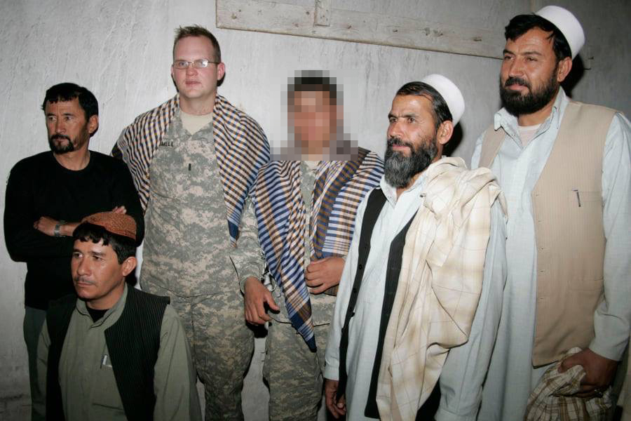 'Cover your daughters, stay in line': U.S. veteran tries to help Afghan interpreter escape Kabul by text