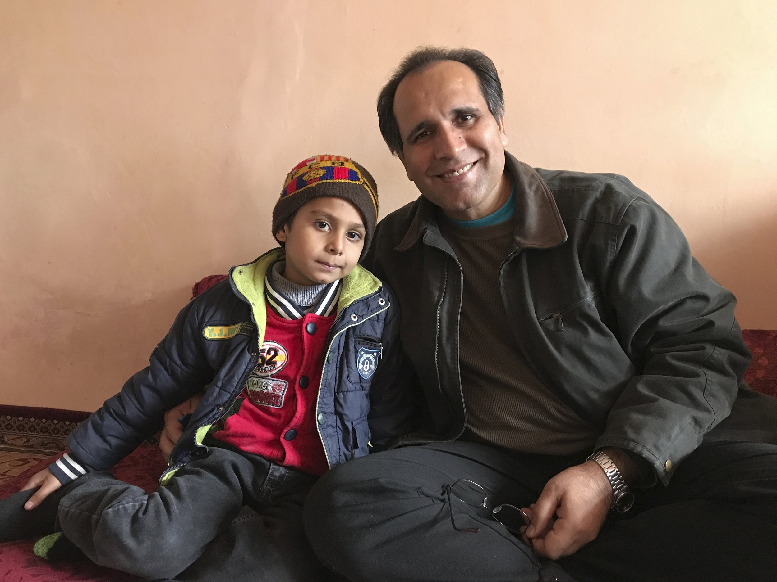 A Florida couple's agonizing wait to adopt an Afghan boy takes on new urgency