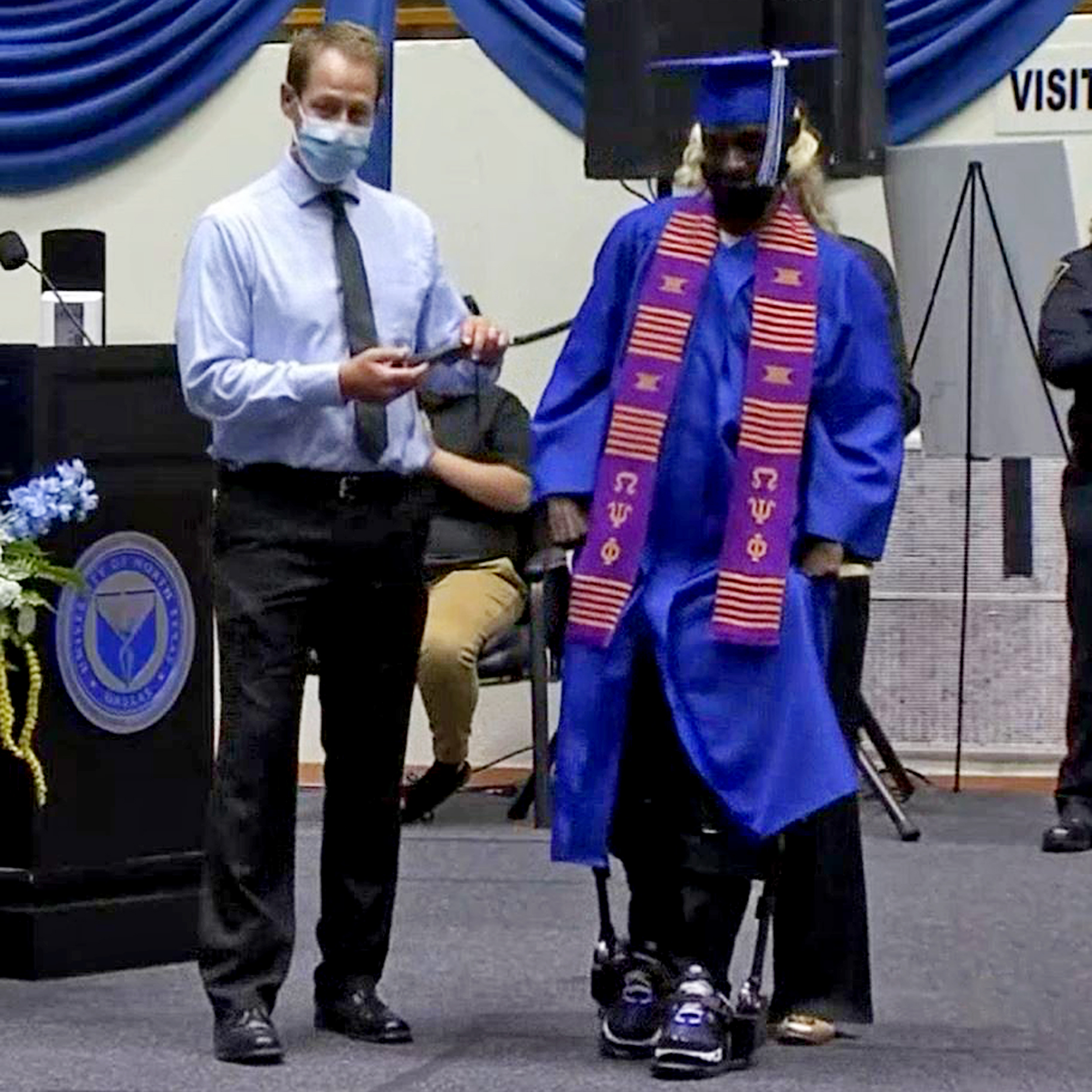 Paralyzed former football player walks across stage at college graduation