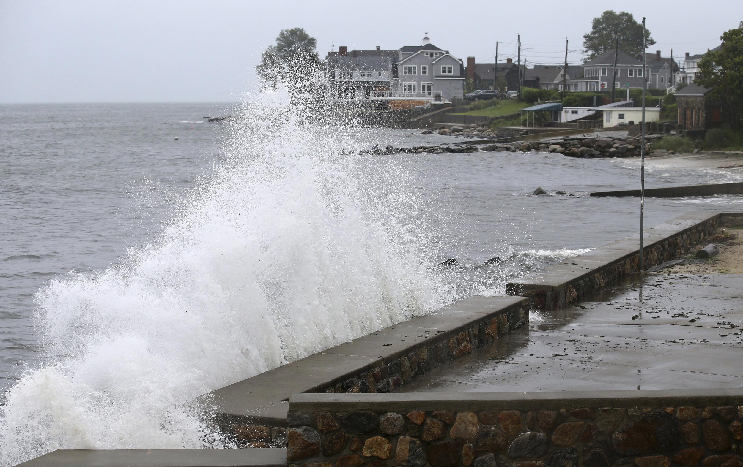 Tropical Storm Henri downgraded ahead of landfall but still presents danger, officials say