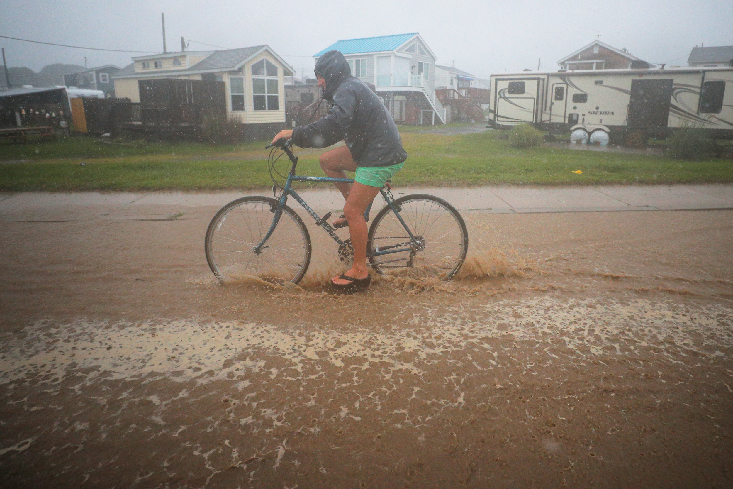 Henri lingers over Northeast, dropping more rain on saturated ground