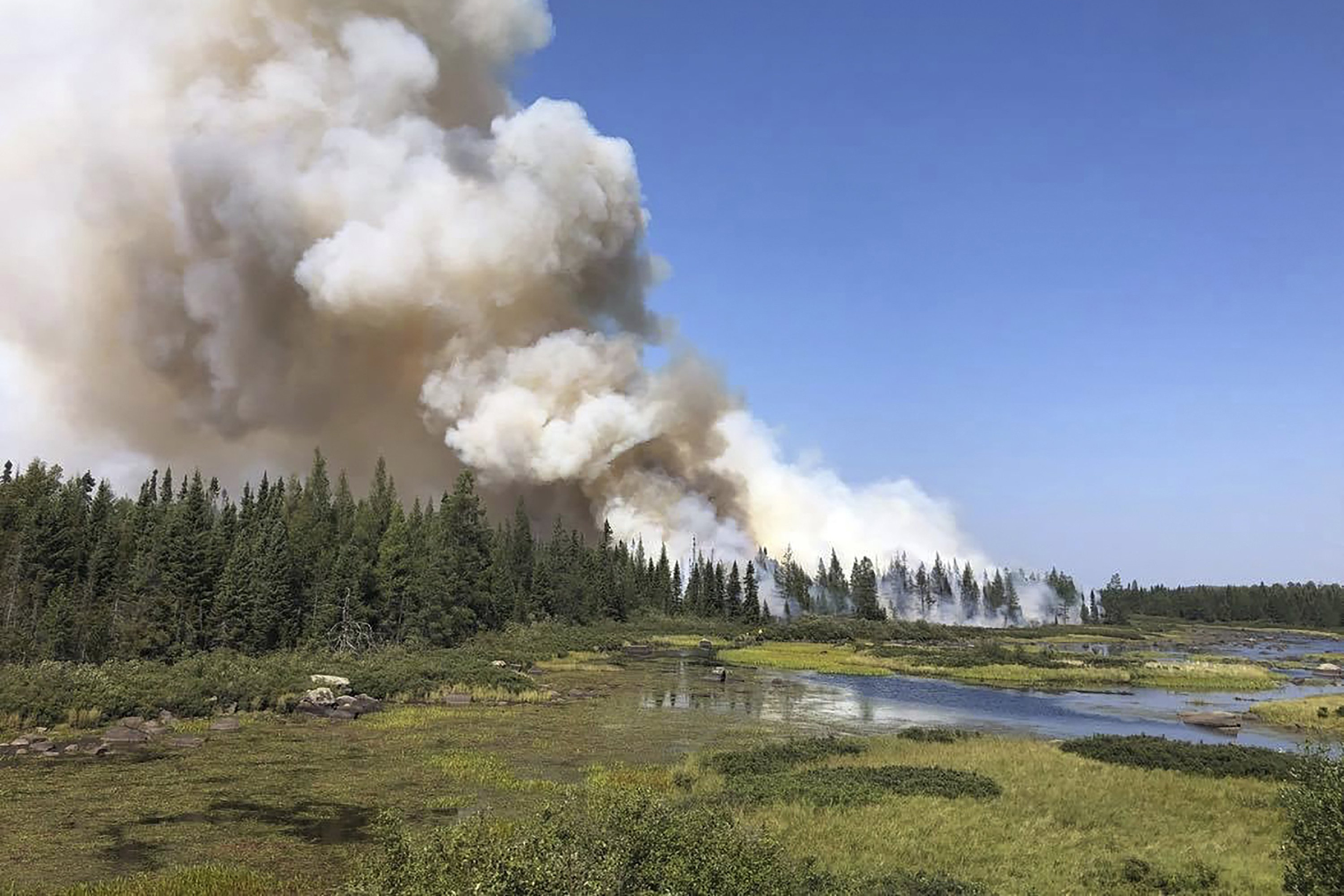 Minnesota wildfire doubles in size, creates its own weather