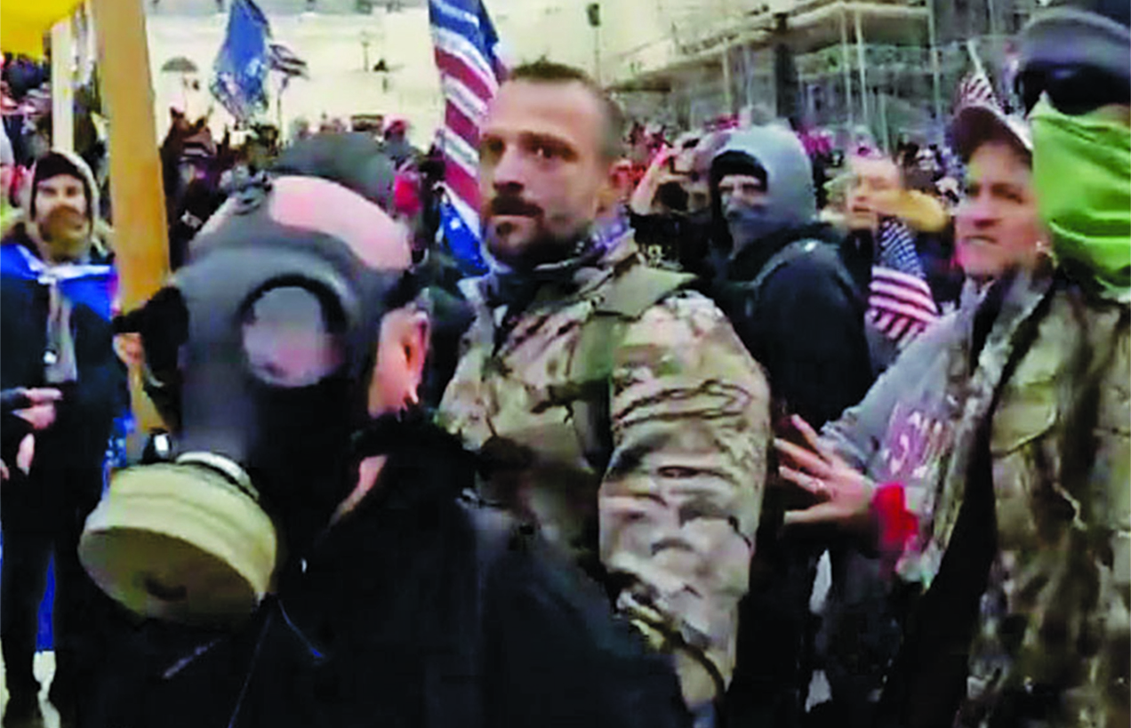 Capitol riot suspect charged with assault after allegedly throwing photographer over wall