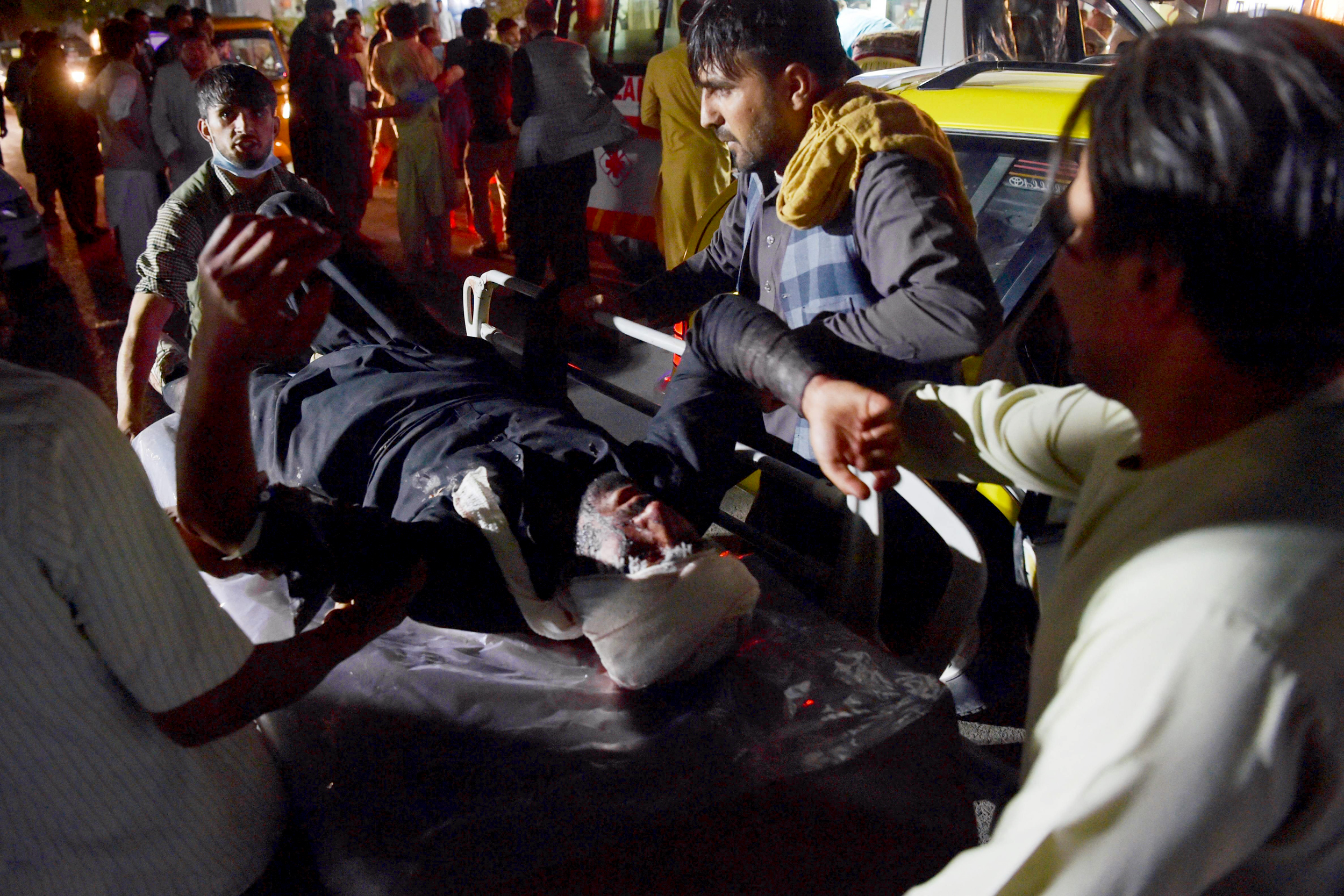 Two explosions outside Kabul airport leave U.S., civilian casualties amid evacuations