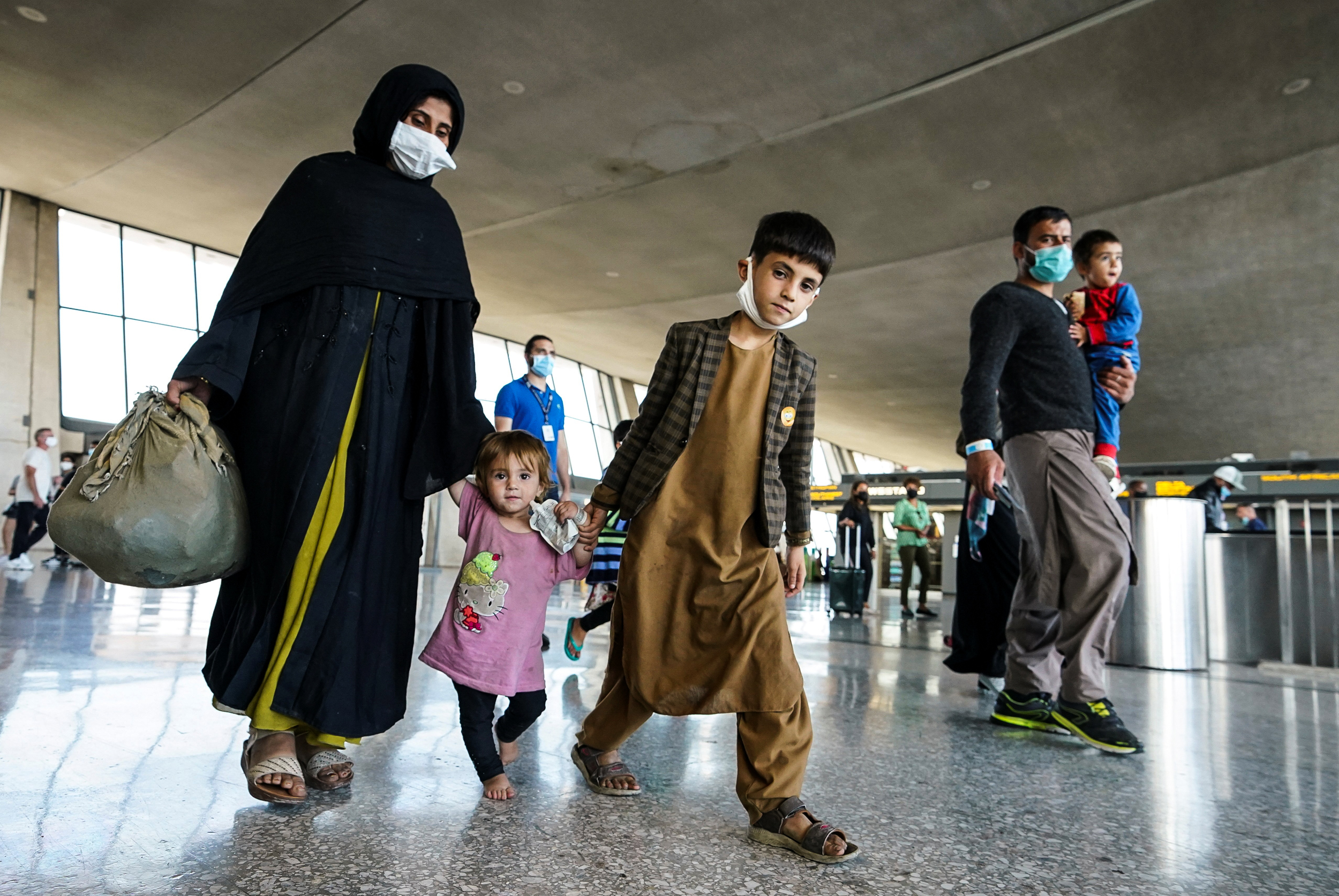 Biden administration sets up mass Covid vaccination site for Afghan evacuees