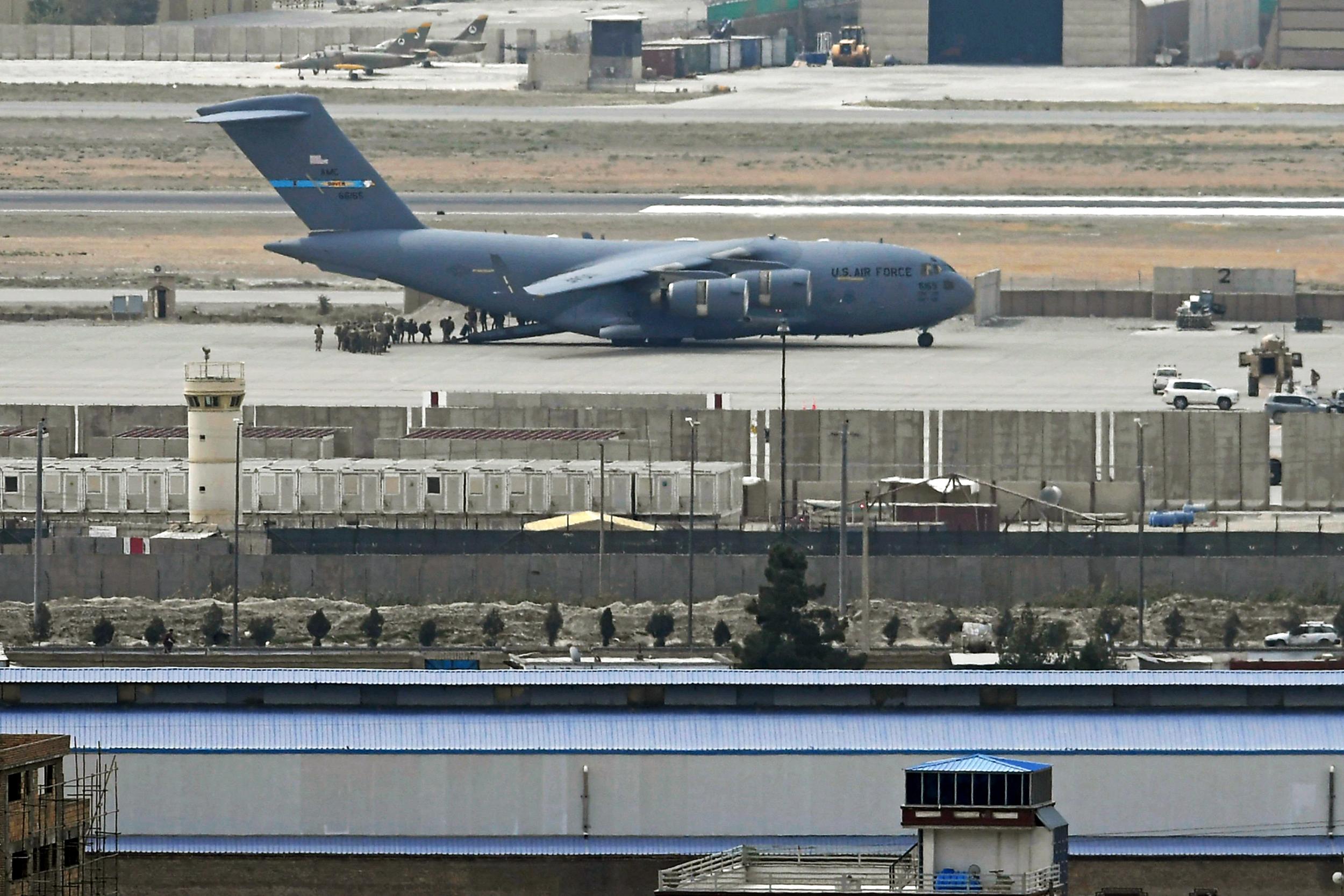 Rockets fired toward Kabul airport; U.S. evacuation 'uninterrupted'