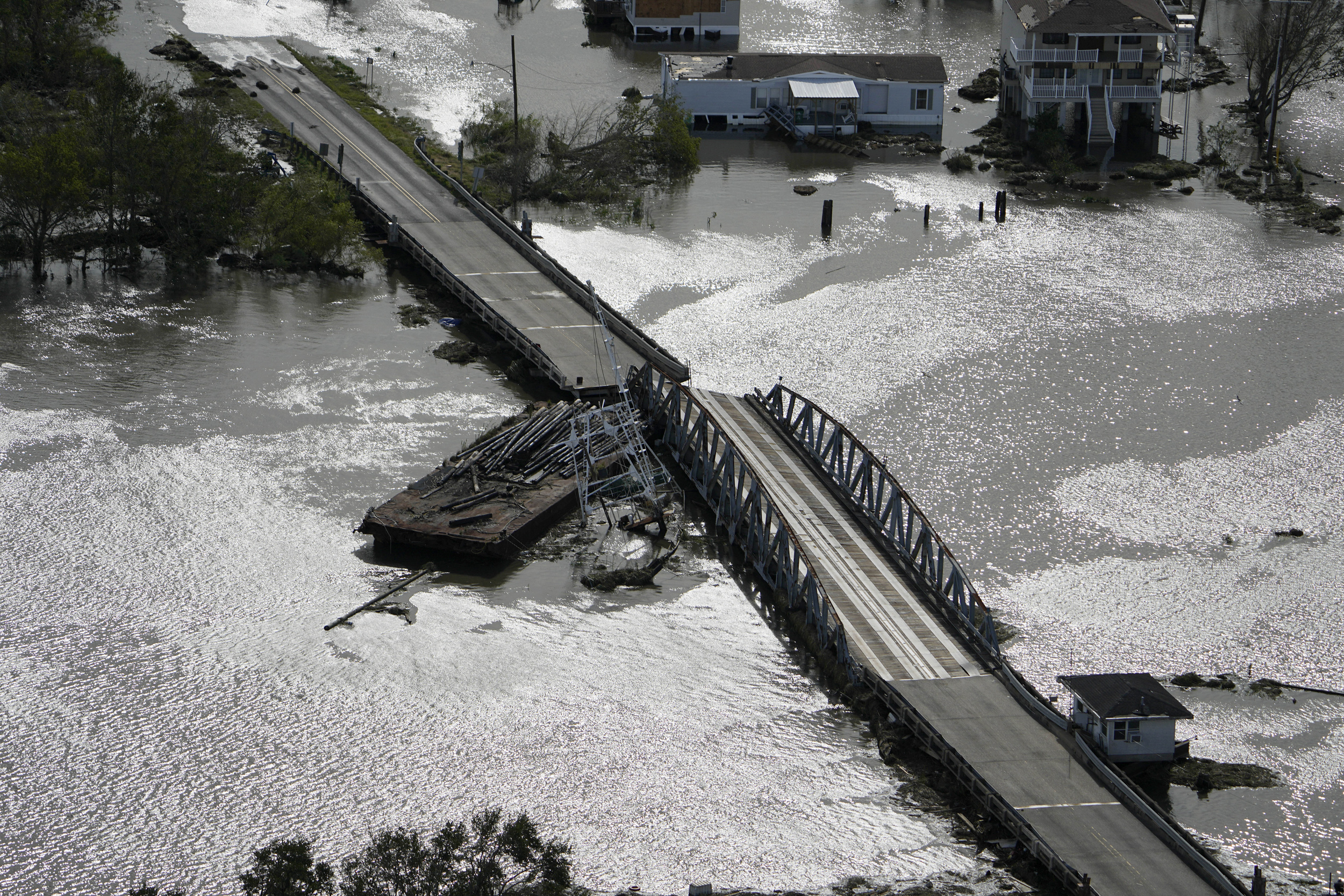 Weakened Ida moves through Mississippi as Louisiana picks up the pieces