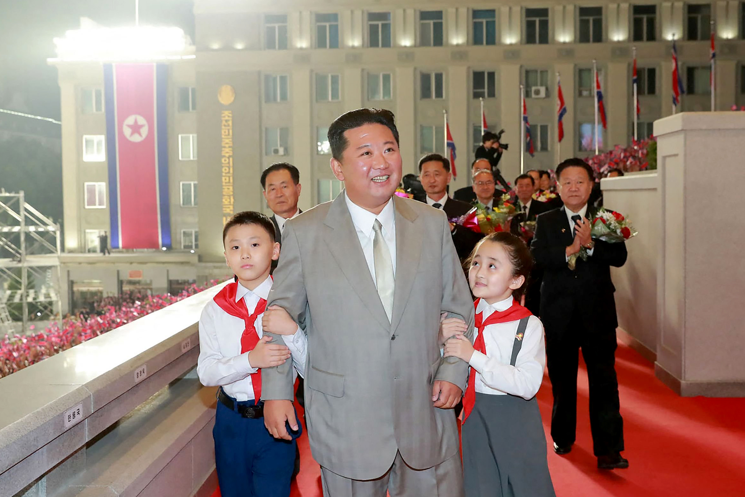 Hazmat suits, no missiles and a slimmer Kim: North Korea holds military parade