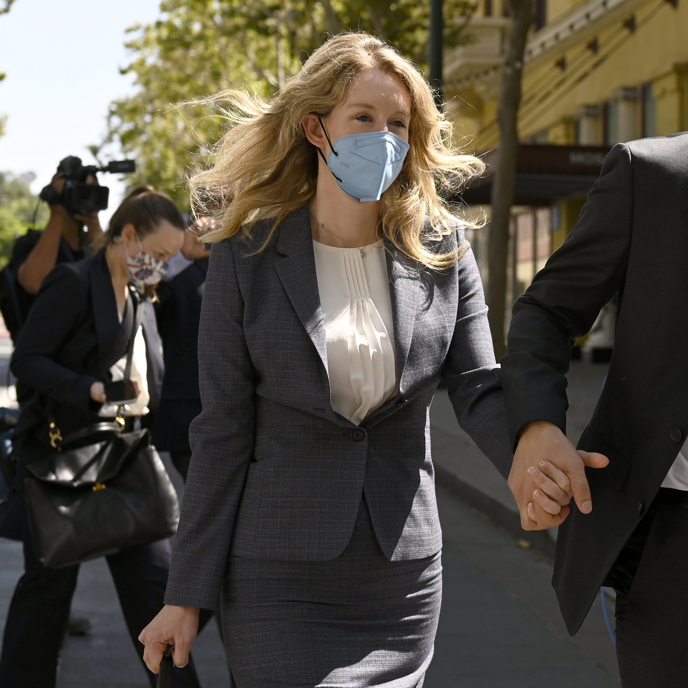 Elizabeth Holmes trial delayed after juror potentially exposed to Covid