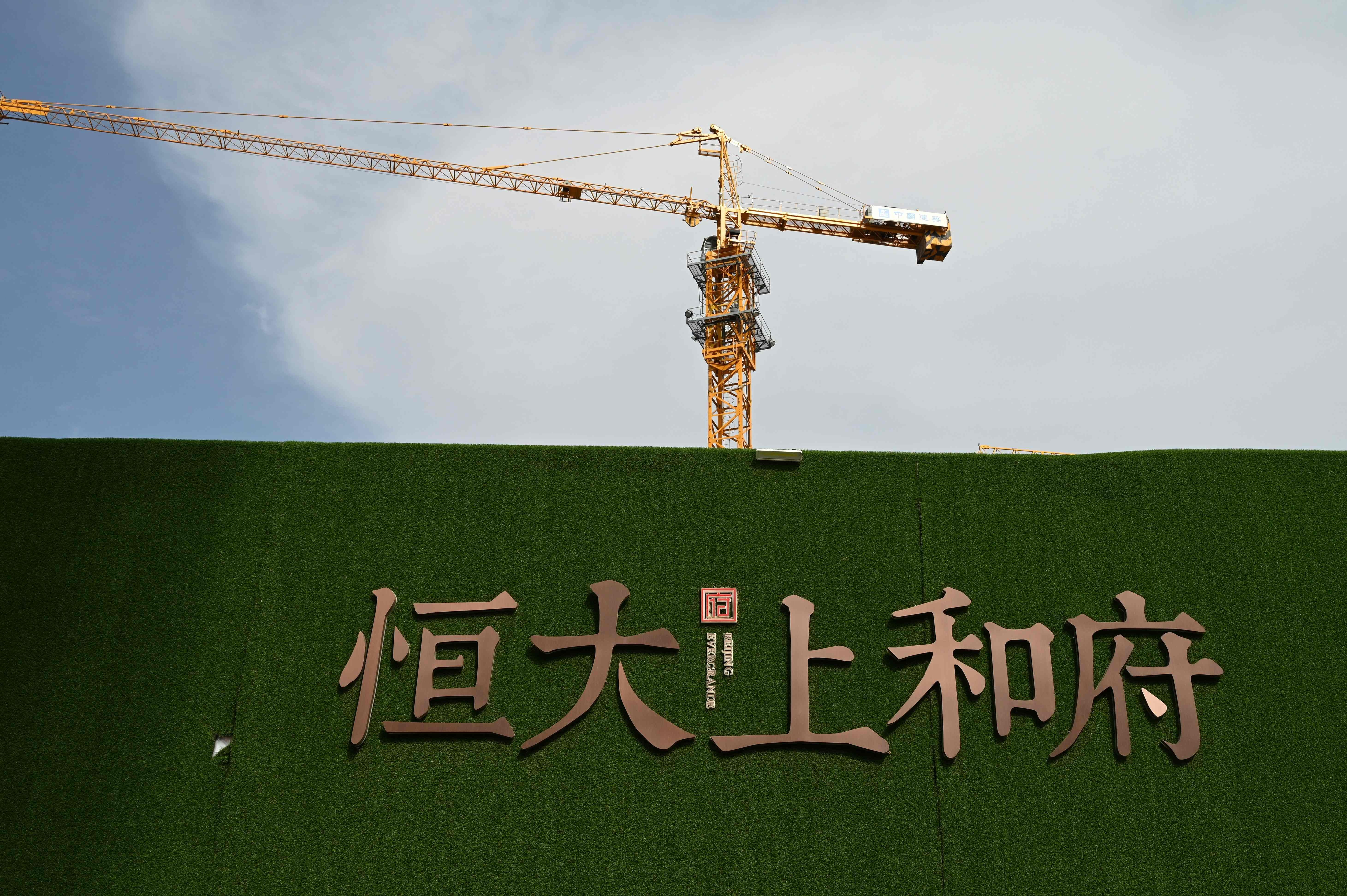 Chinese developer Evergrande denies bankruptcy rumors as protests mount