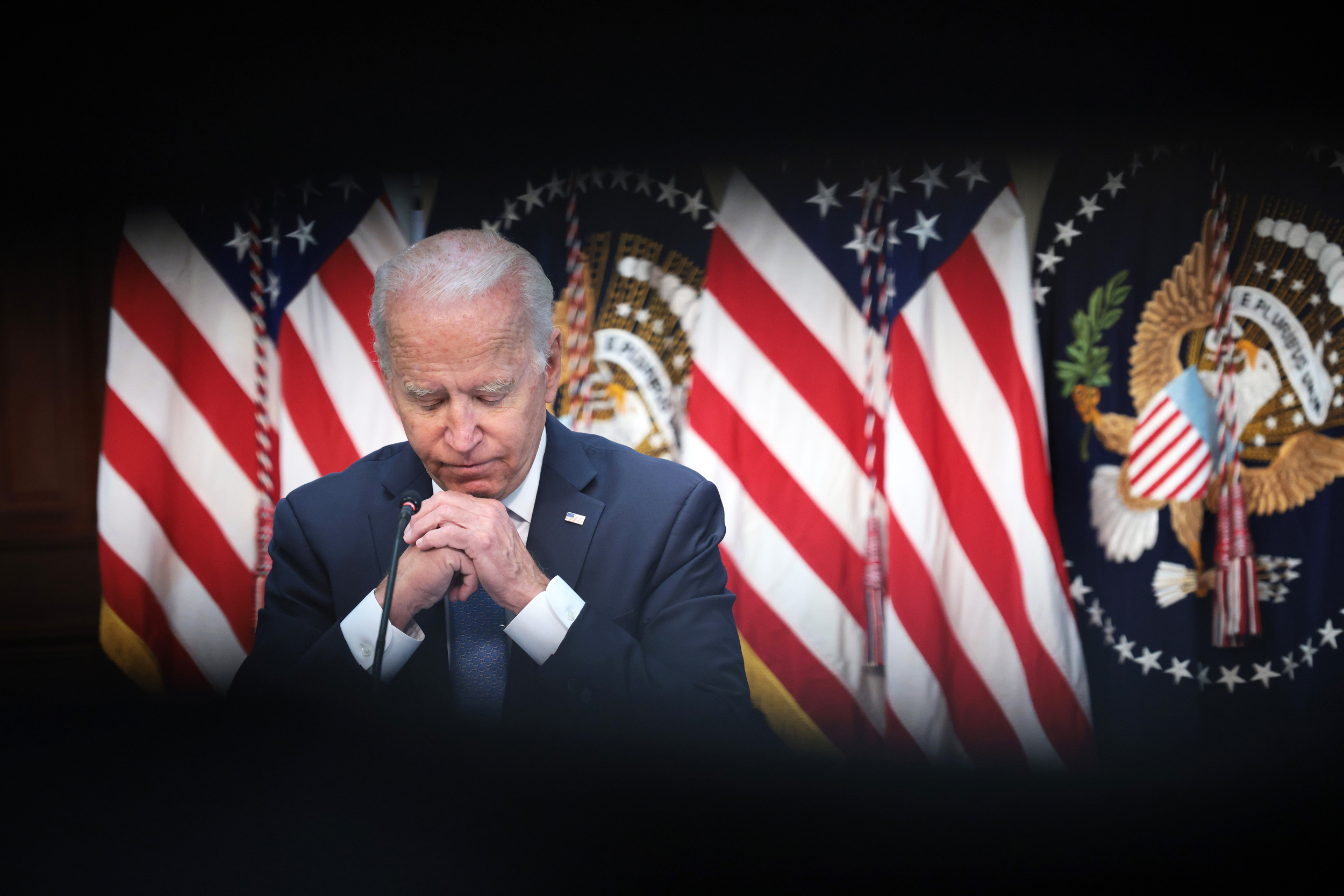Biden faces booster plan blowback at home and abroad
