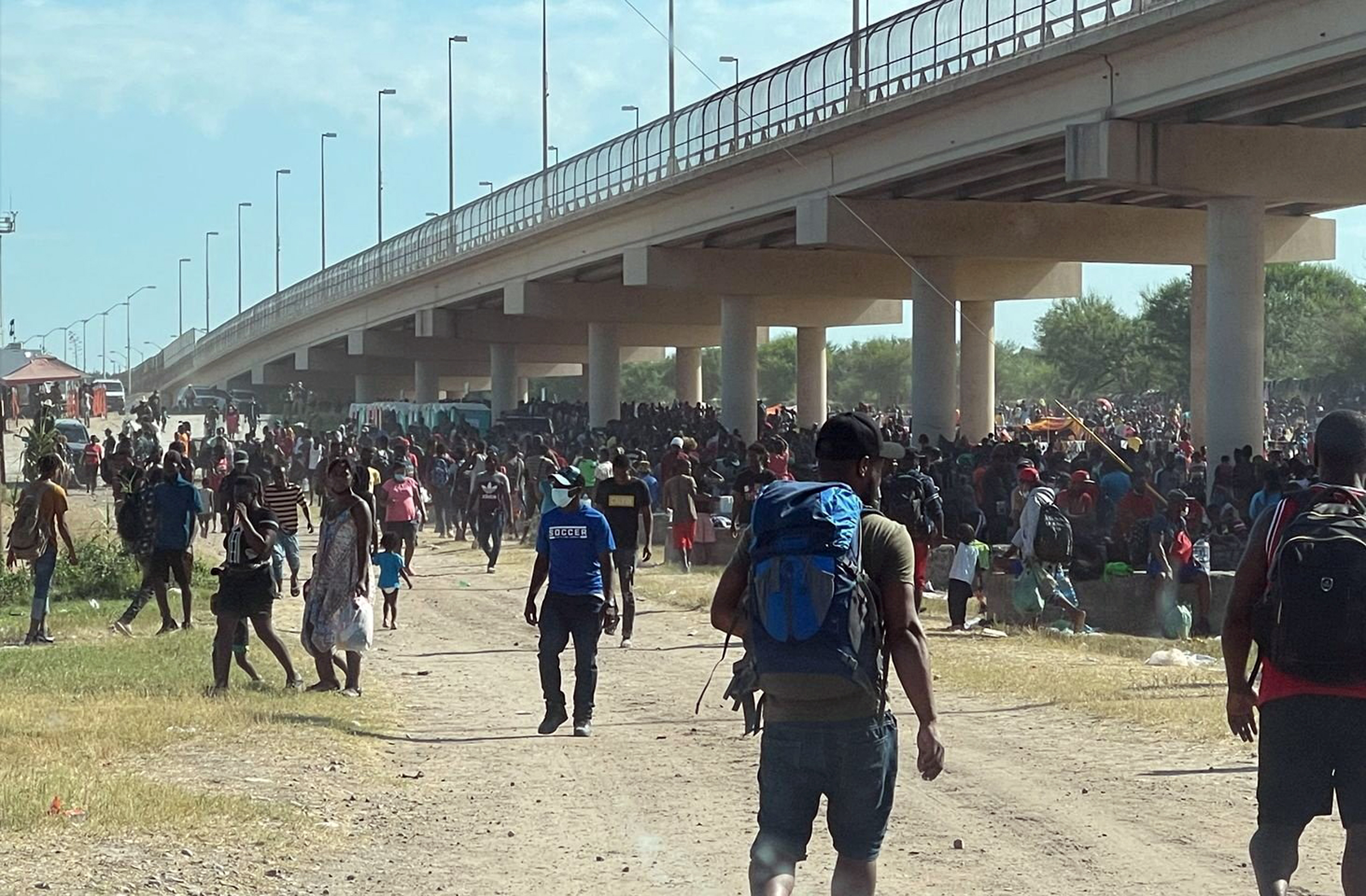Biden admin ramps up deportation of Haitians as 10,000 migrants shelter under Texas bridge