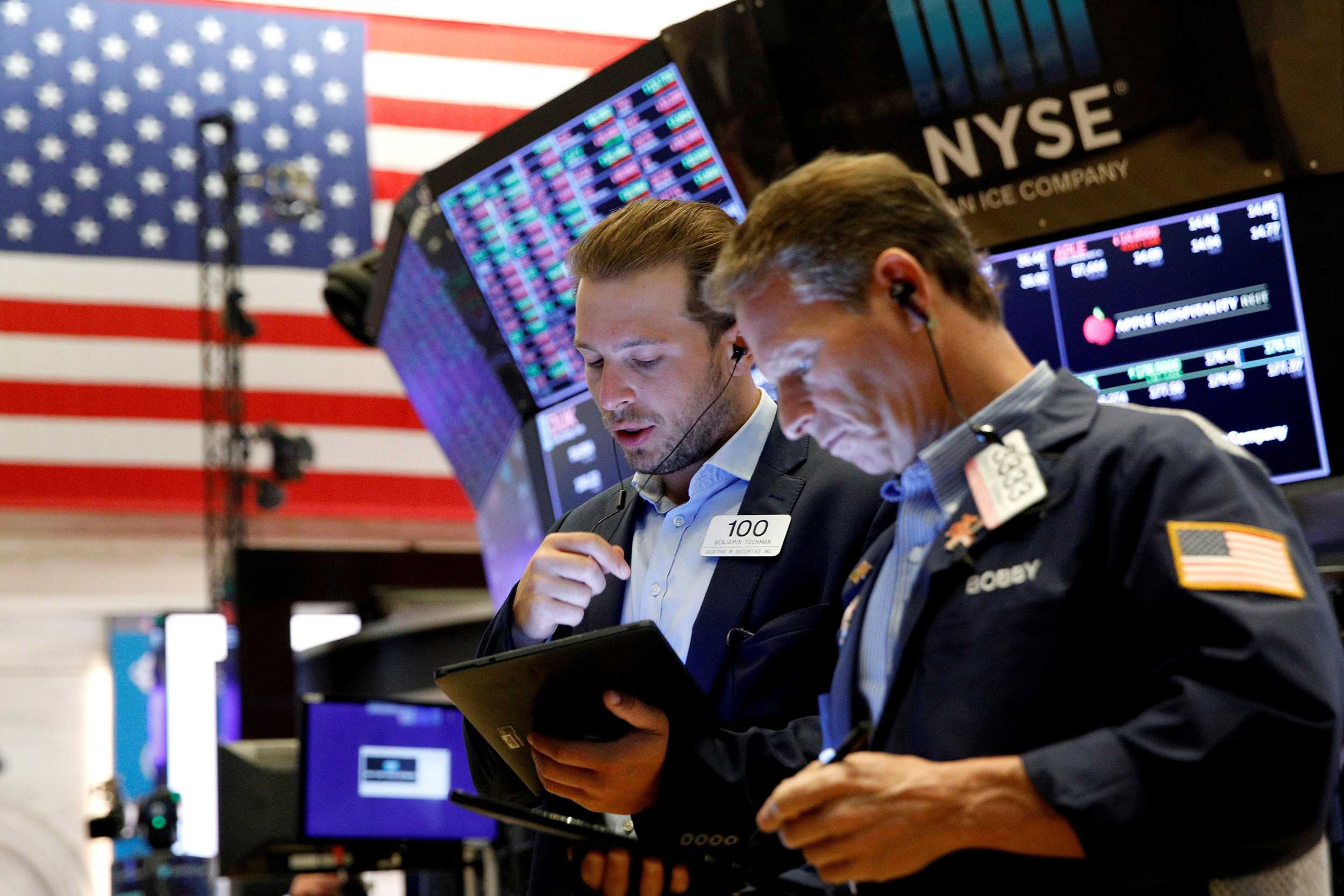Wall Street closes in the red, triggered by selloff in China and anxiety over the Fed's next move