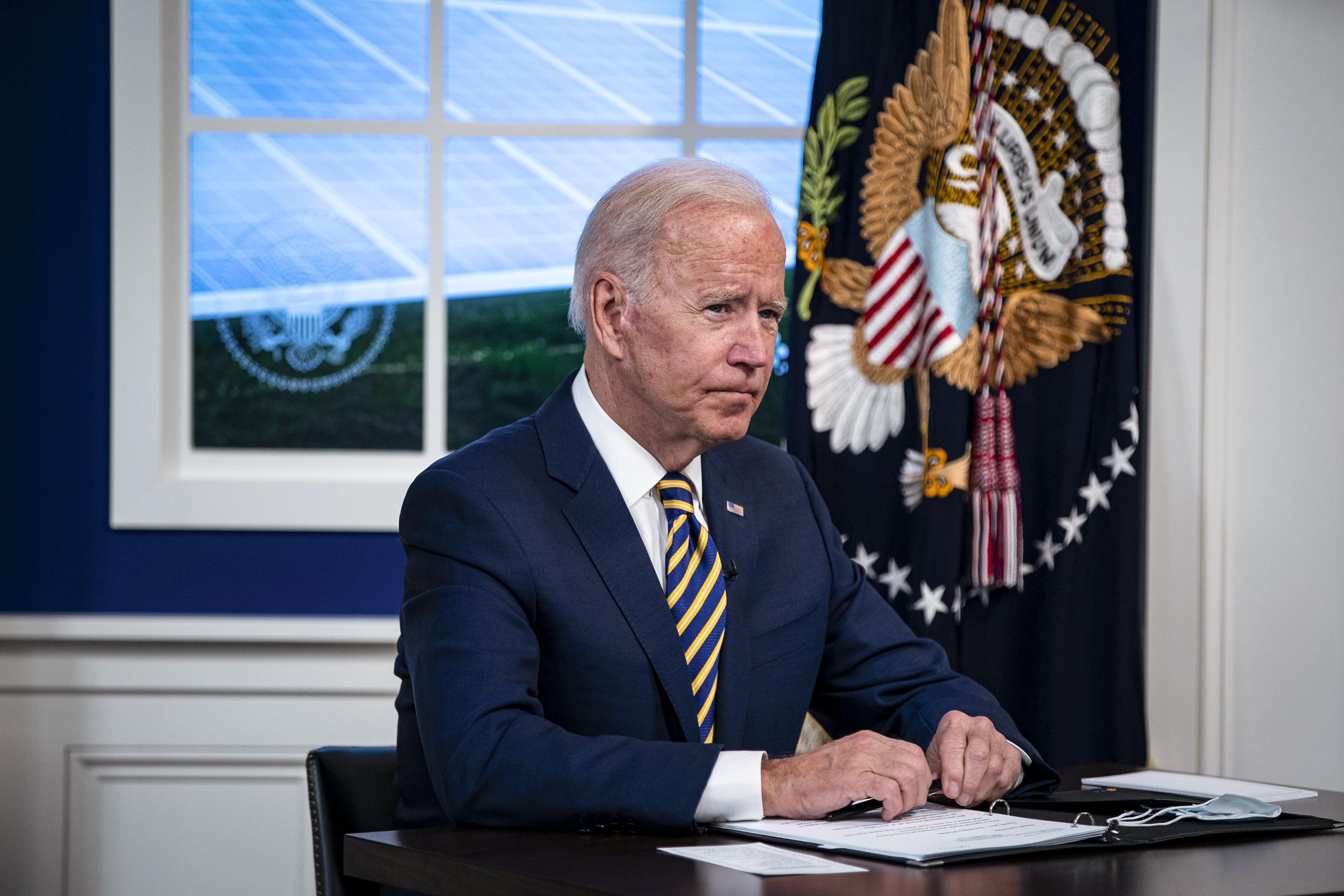 Averting government shutdown, Biden signs bill hours before deadline
