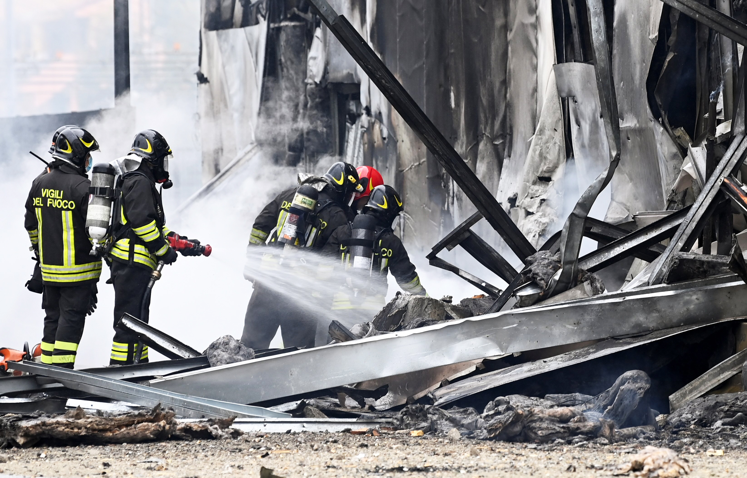 8 reported dead after plane crashes into building in Italy