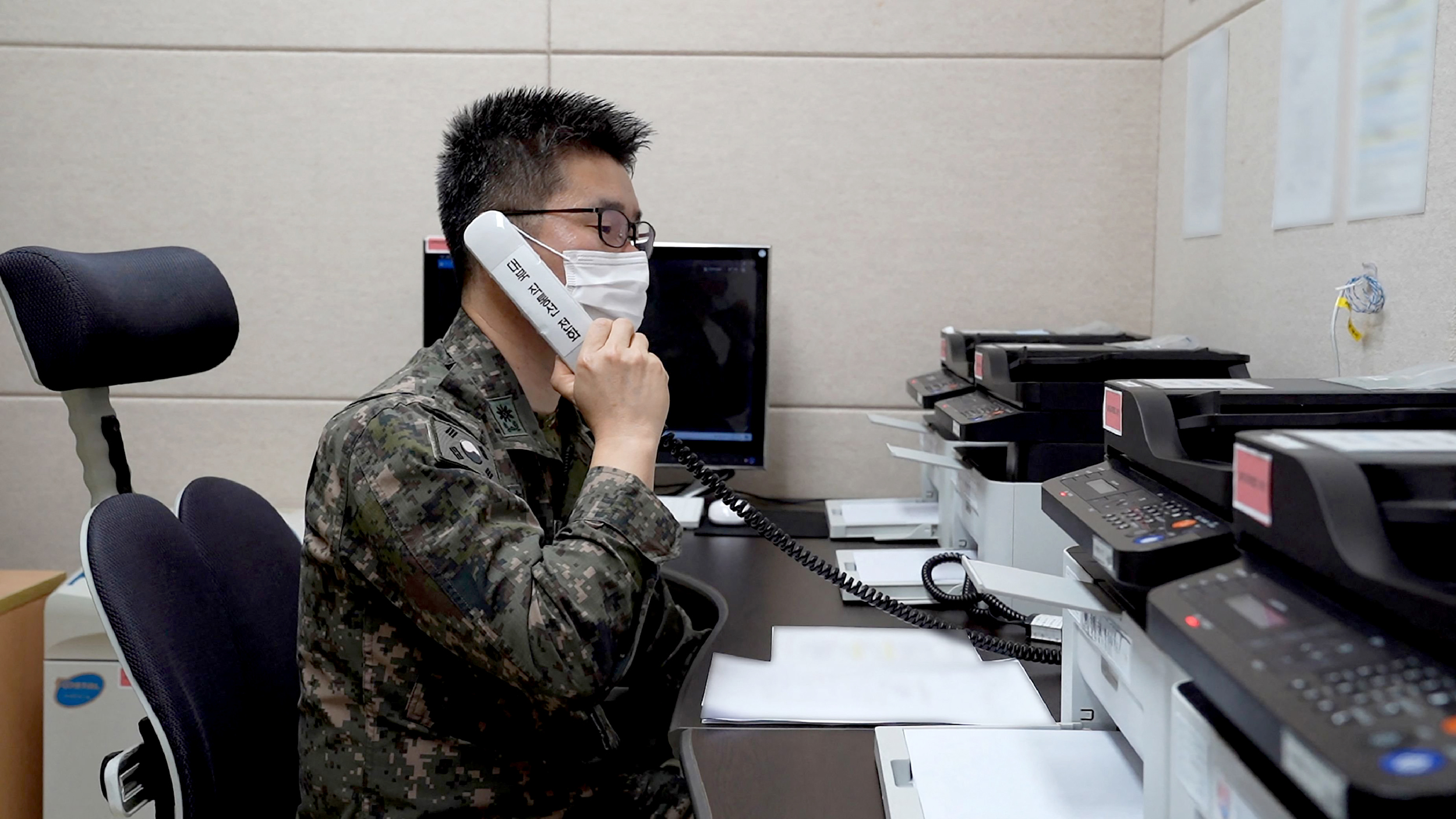 Two Koreas reopen hotlines as North urges South to mend ties
