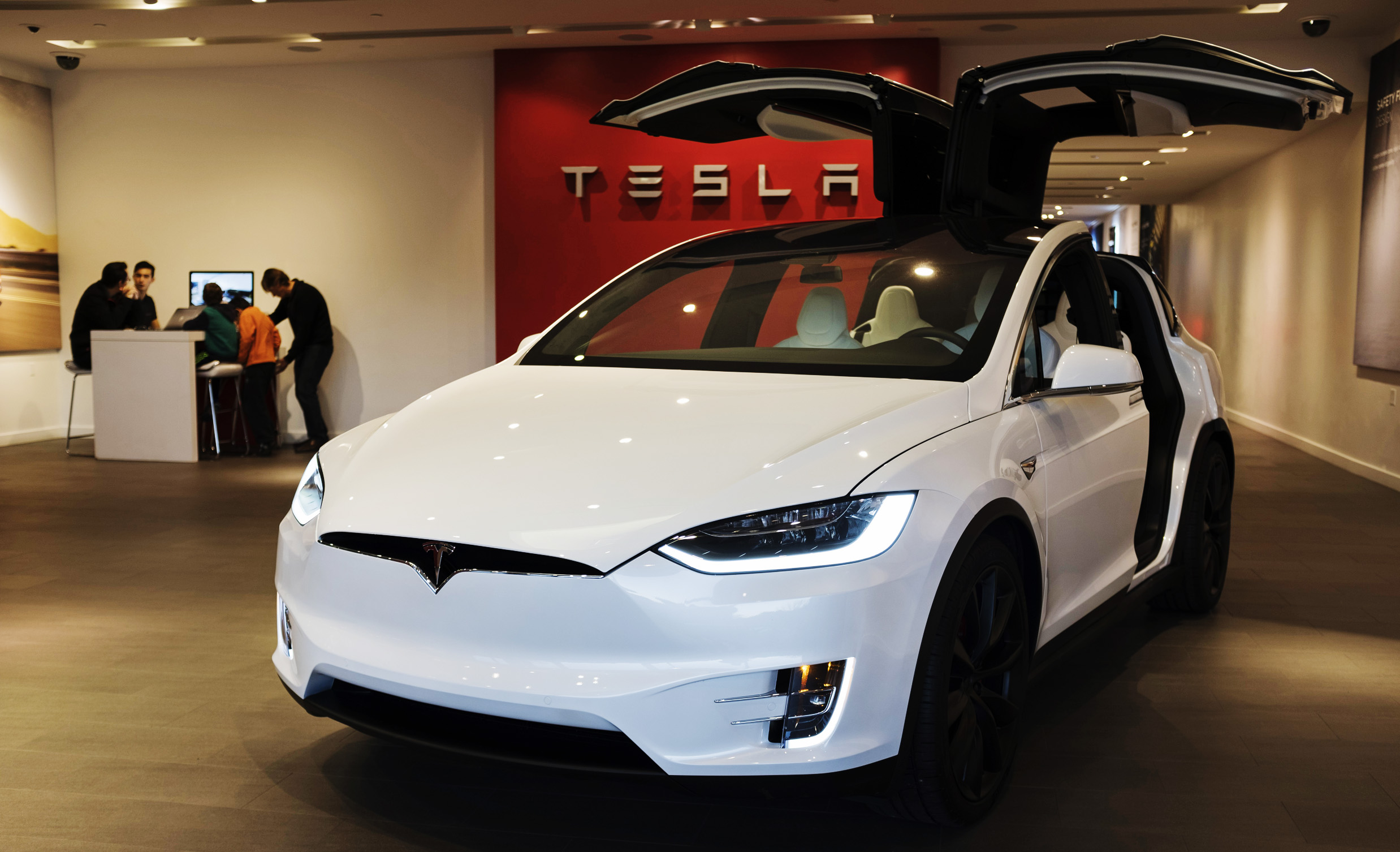 Tesla buys $1.5 billion in bitcoin and plans to start accepting it as  payment