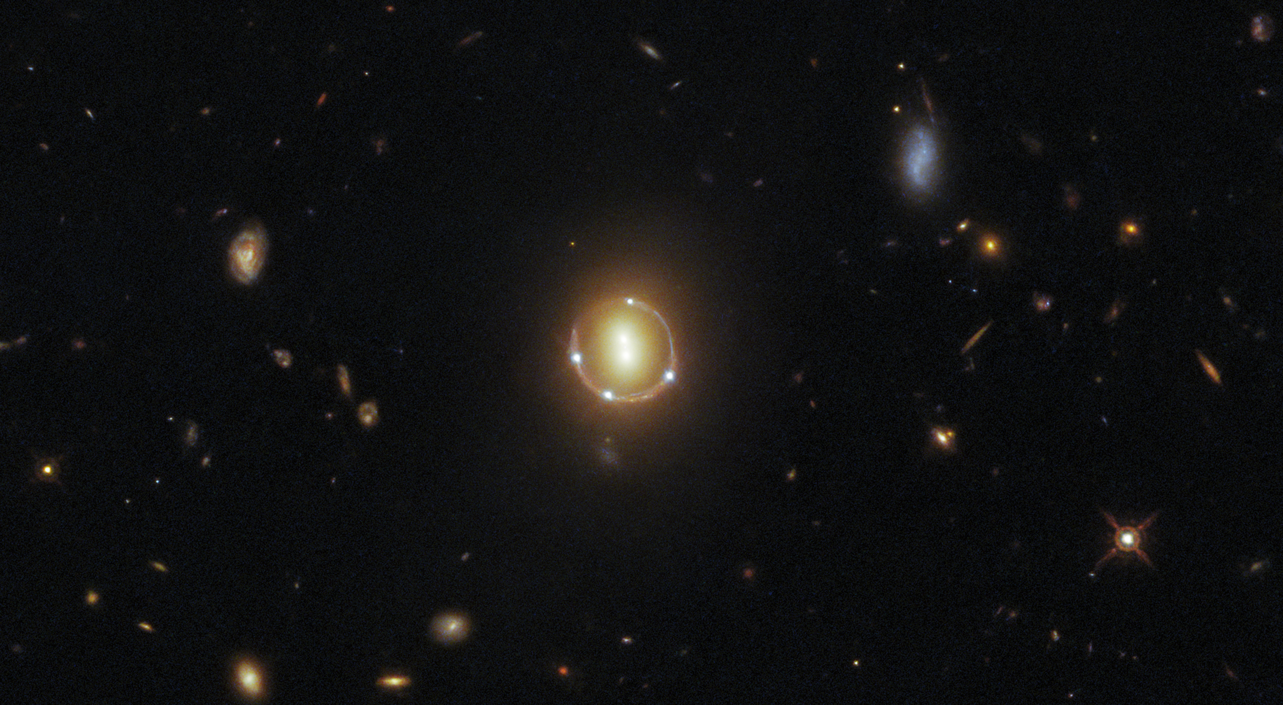 Rare 'Einstein Ring' captured by Hubble reveals the depths of the universe