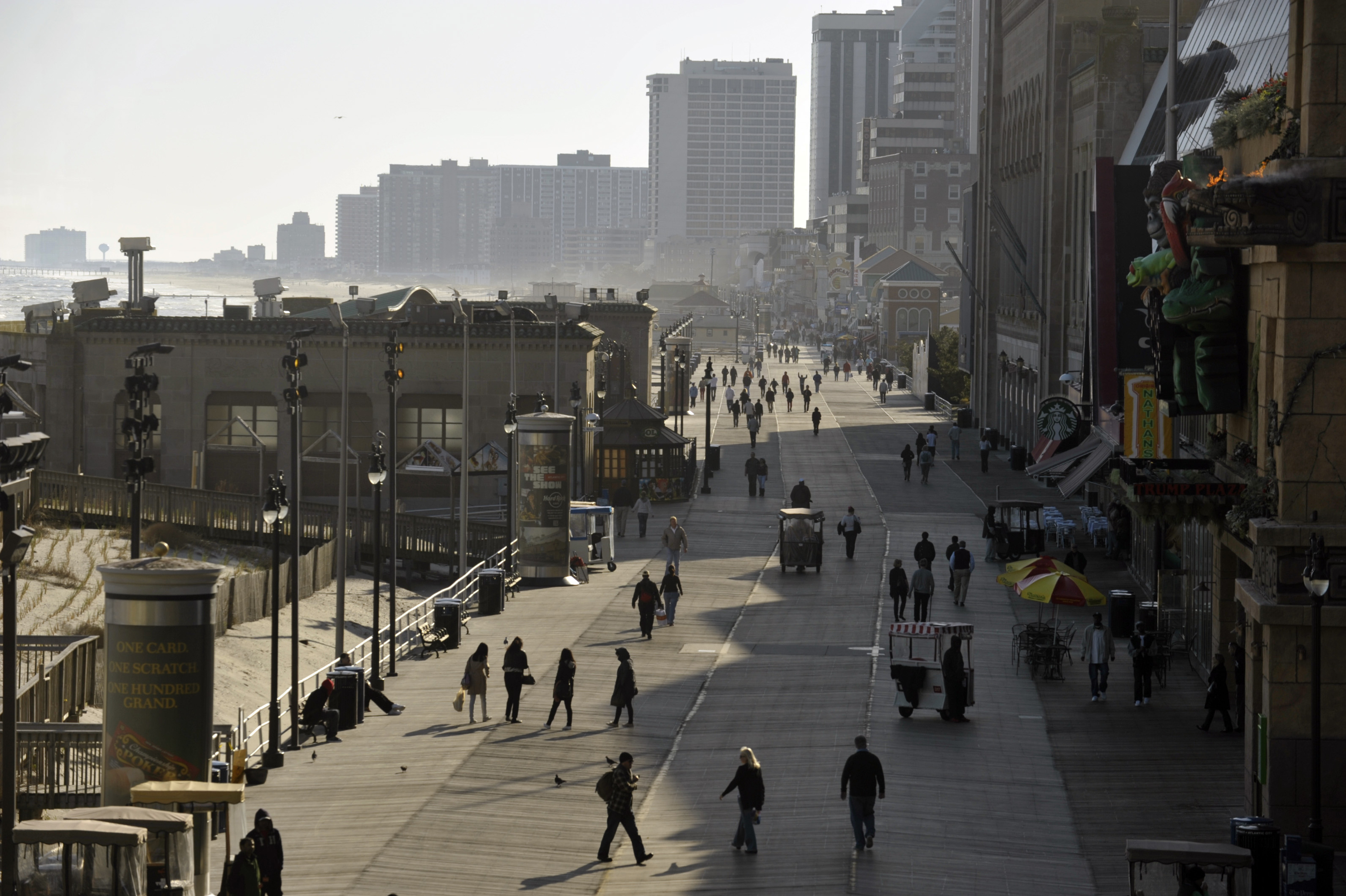 People walk on the Atlantic City boardwalk looking south from Caesars Atlantic City Thursday, April 25, 2013. Hurricane Sandy did mimimal damage to At...
