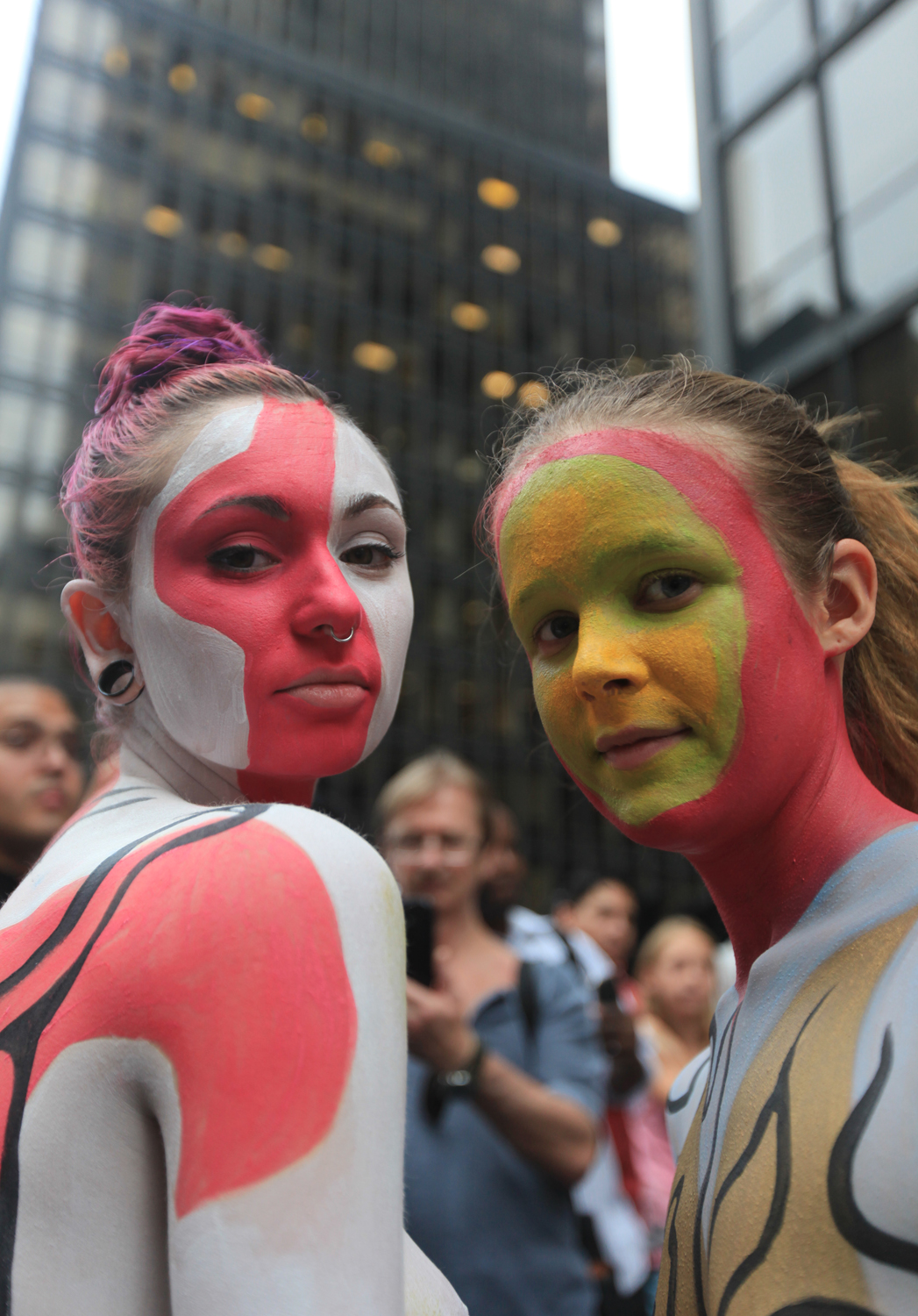 Nudists Dylan Hall, left, and Felicity Jones participate in public body painting event by artist Andy Golub near New York's Times Square on July 31, 2013.
