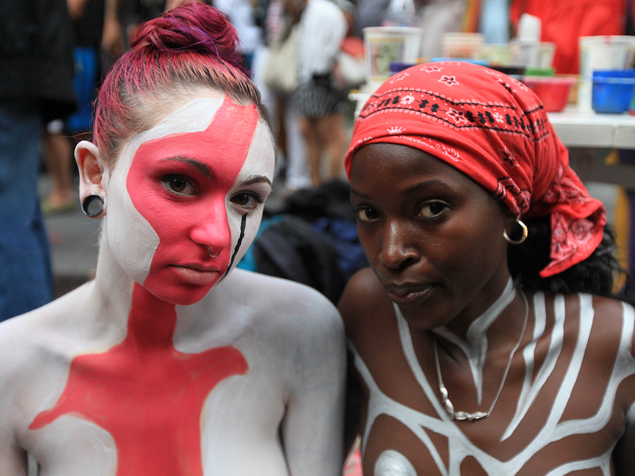 Nudists Dylan Hall, left, and Myscha participate in public body painting event by artist Andy Golub near New York's Times Square on July 31, 2013.
