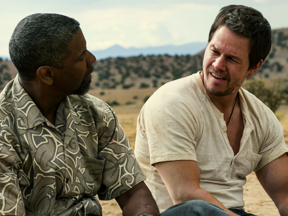 This image released by Universal Pictures shows Denzel Washington, left, and Mark Wahlberg in a scene from