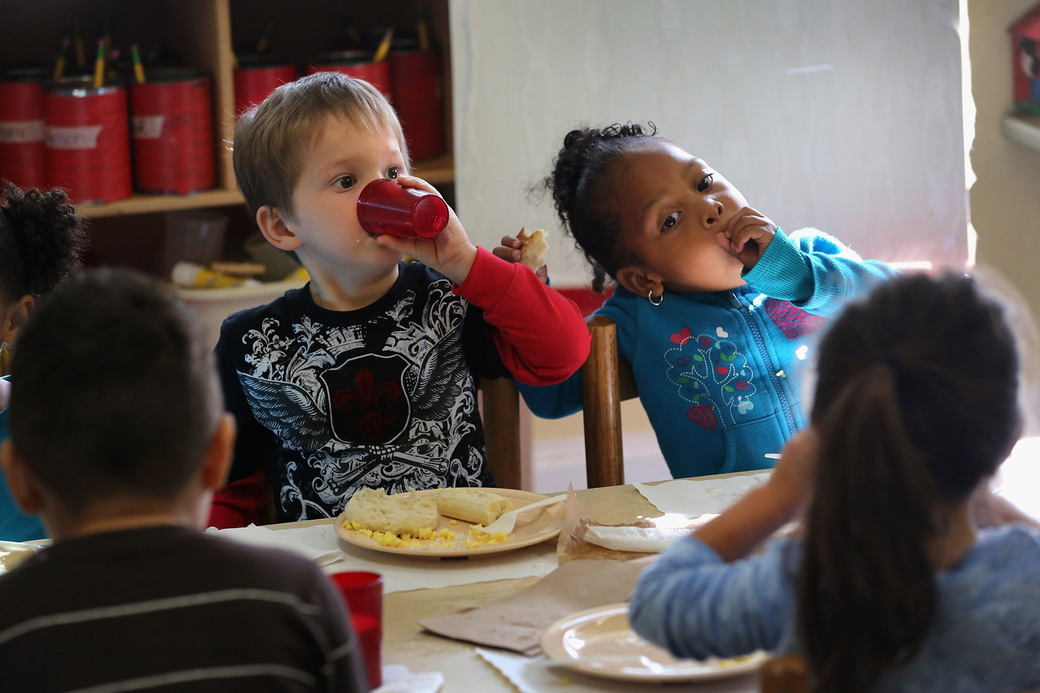 WOODBOURNE, NY - SEPTEMBER 20:  Children eat breakfast at the federally-funded Head Start Program school on September 20, 2012 in Woodbourne, New York...