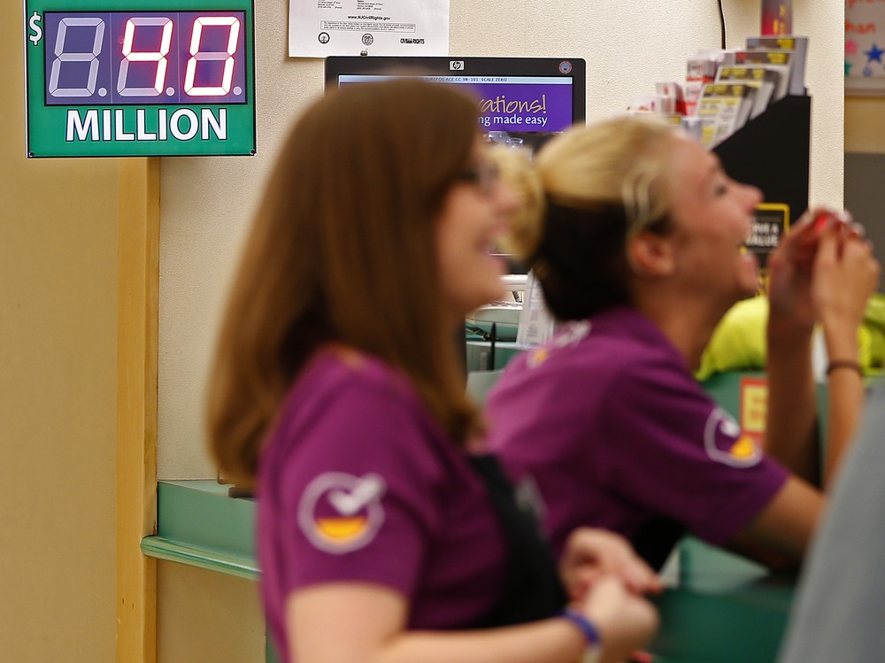 Employees chat at the Customer Service area at Stop & Shop in South Brunswick, N.J. Thursday. The supermarket is where one of the three winning Powerb...