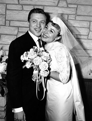 FILE - This Dec. 29, 1957 file photo, shows Eydie Gorme and Steve Lawrence, both 22,  on their wedding day in Las Vegas.  Gorme, a popular nightclub a...