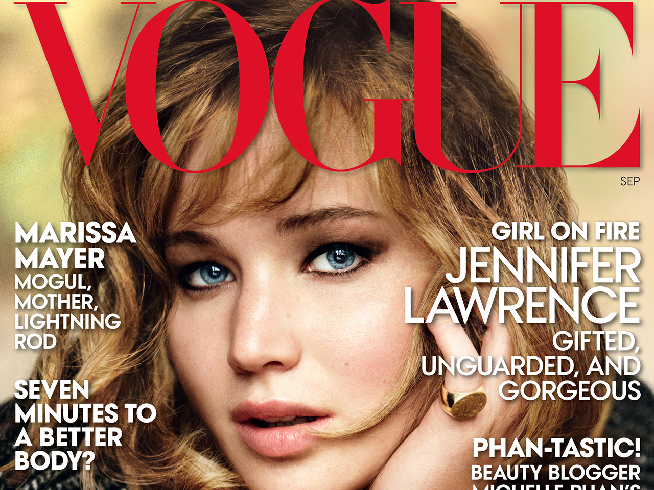 This magazine cover image shot by Mario Testino  and released by Vogue shows actress Jennifer Lawrence on the cover of the September 2013 issue. The i...