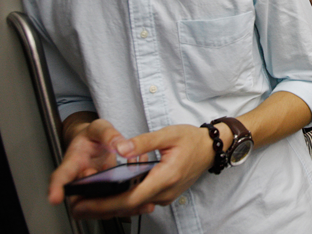 A young man uses his smartphone.