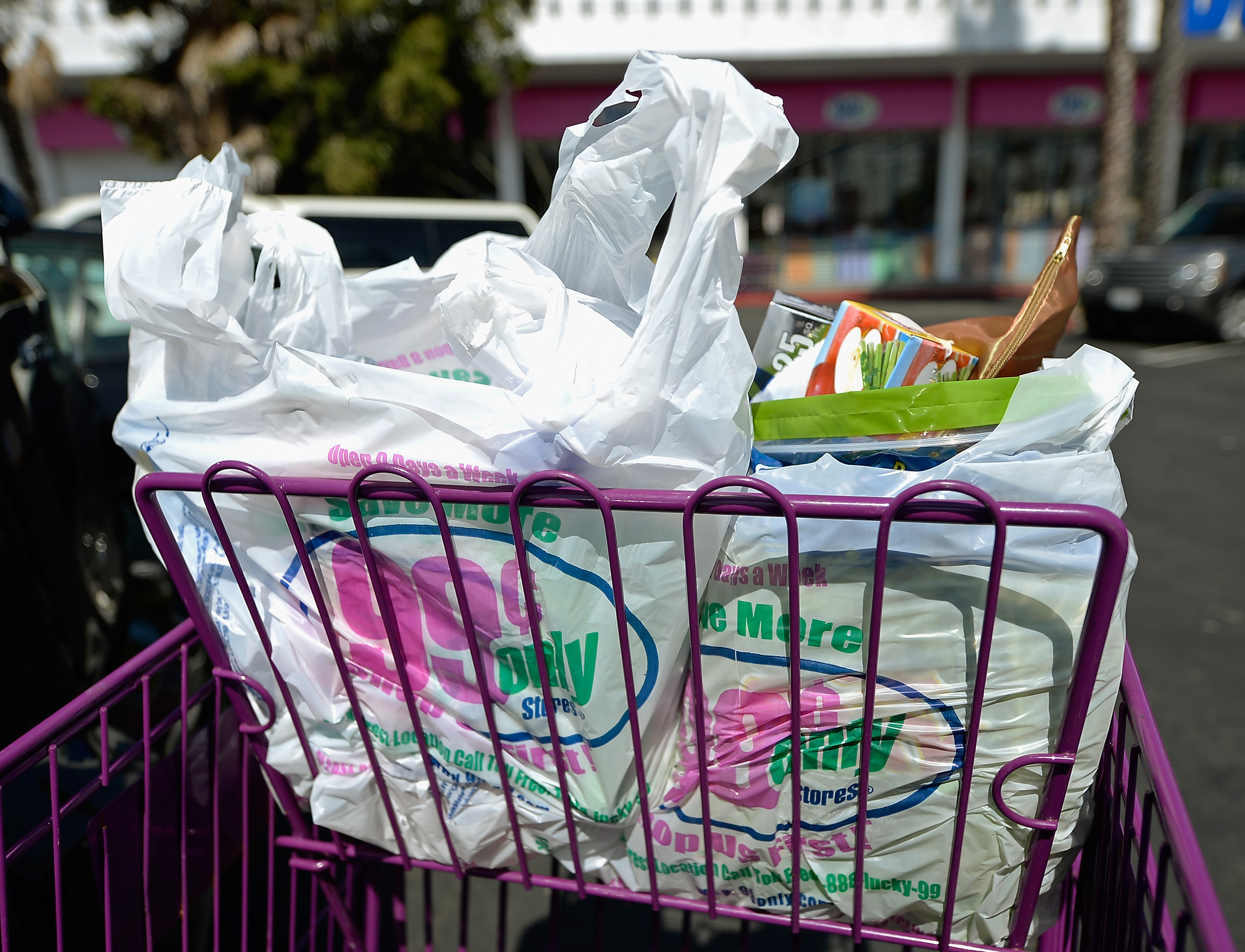 LOS ANGELES, CA - JUNE 18:  Shoppers use plastic grocery bags after shopping at the 99 Cents Only Store on June 18, 2013 in Los Angeles, California.  ...