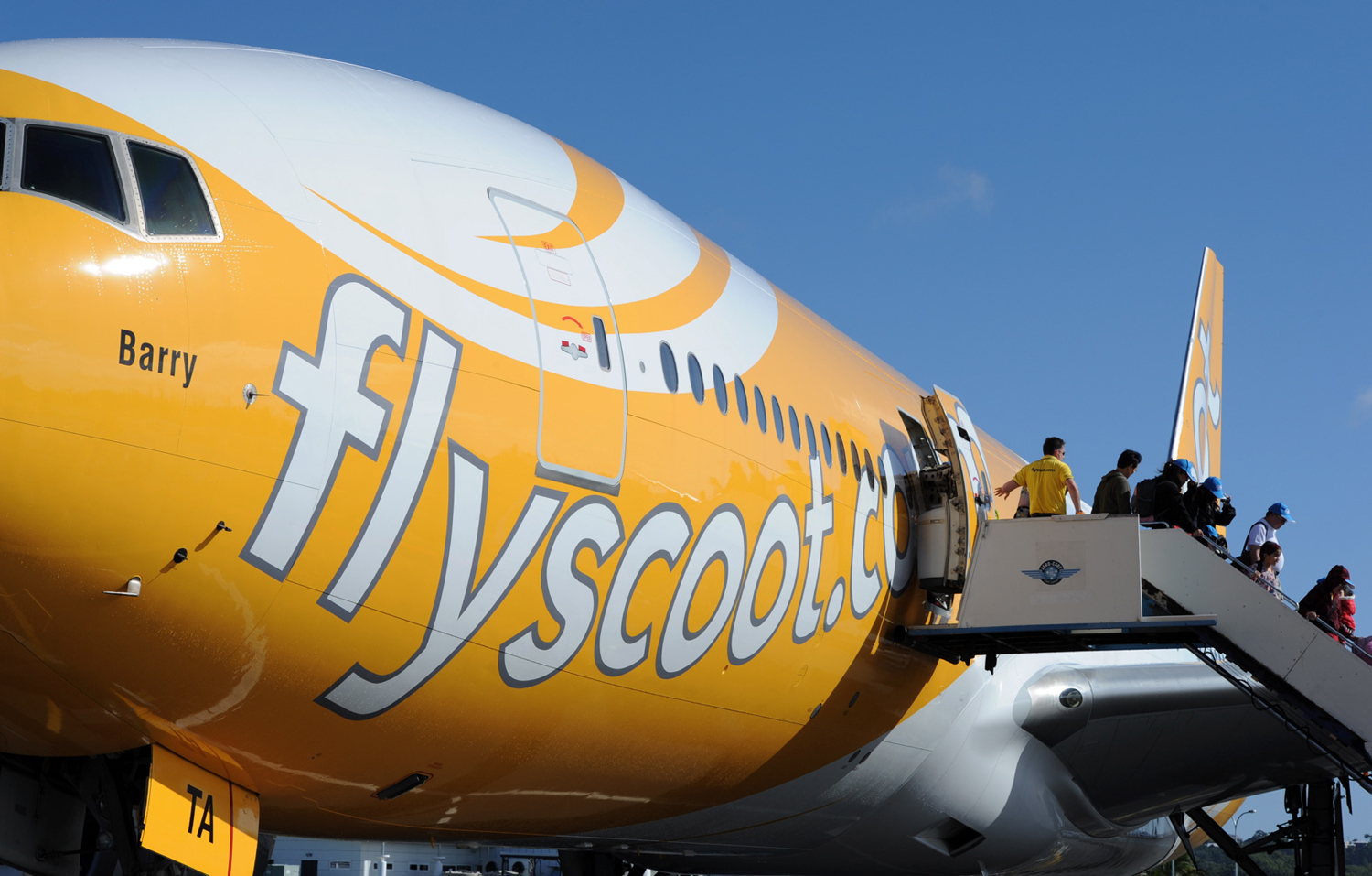 Passengers on the inaugural Singapore to Gold Coast flight disembark at Gold Coast Airport on June 13, 2012, on the Gold Coast, Australia. Scoot, the ...