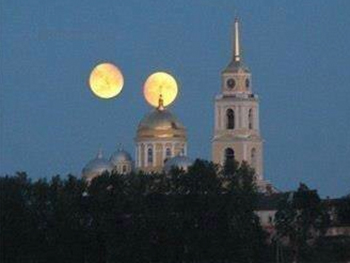 Image: Two moons over monastery