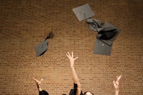 Graduates throwing their mortar boards