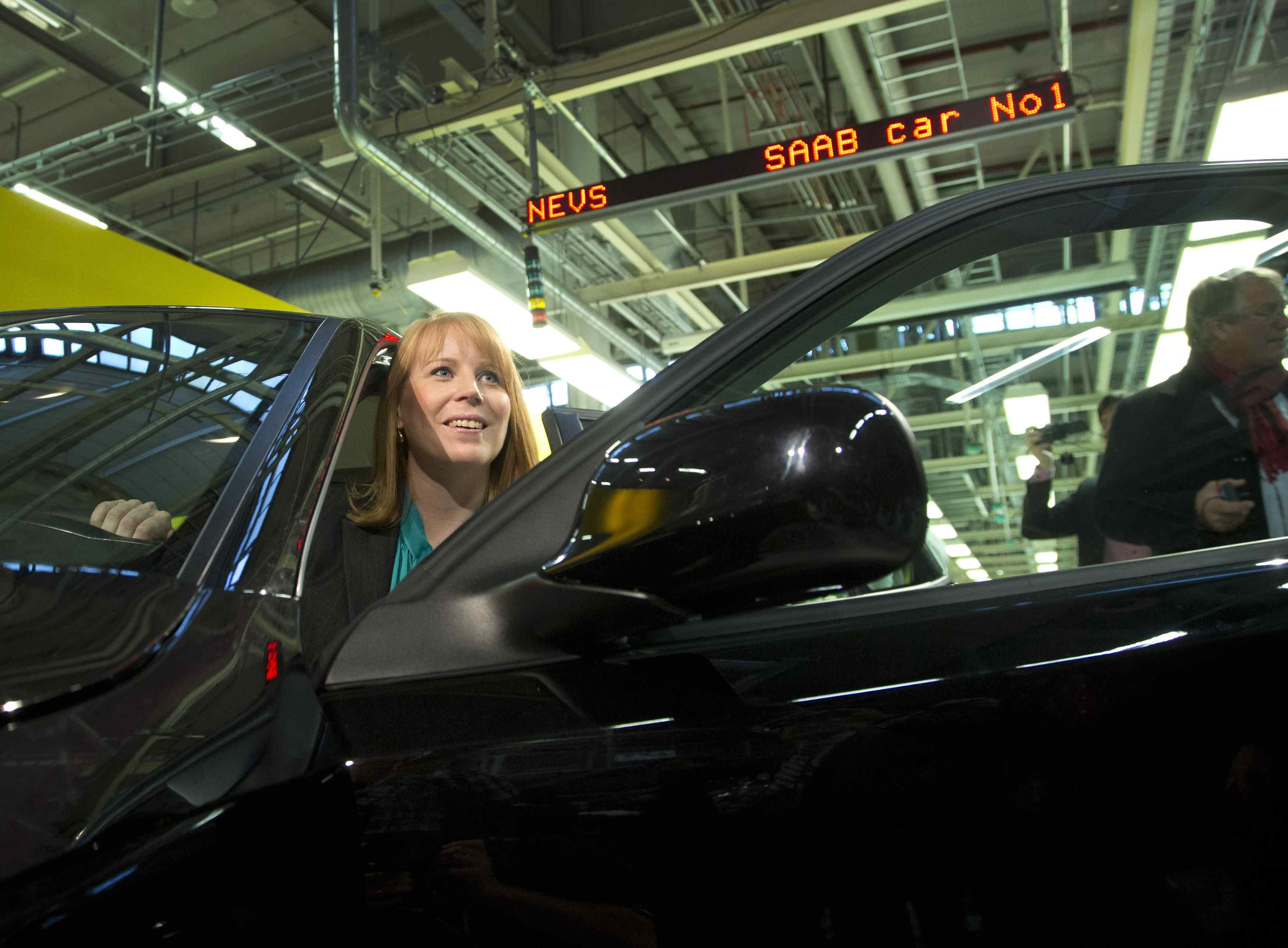 Swedish Minister for Enterprise Annie Loof looks out of a first production NEVS Saab 9-3 Aero at the Trollhattan factory in Sweden on Dec. 2.