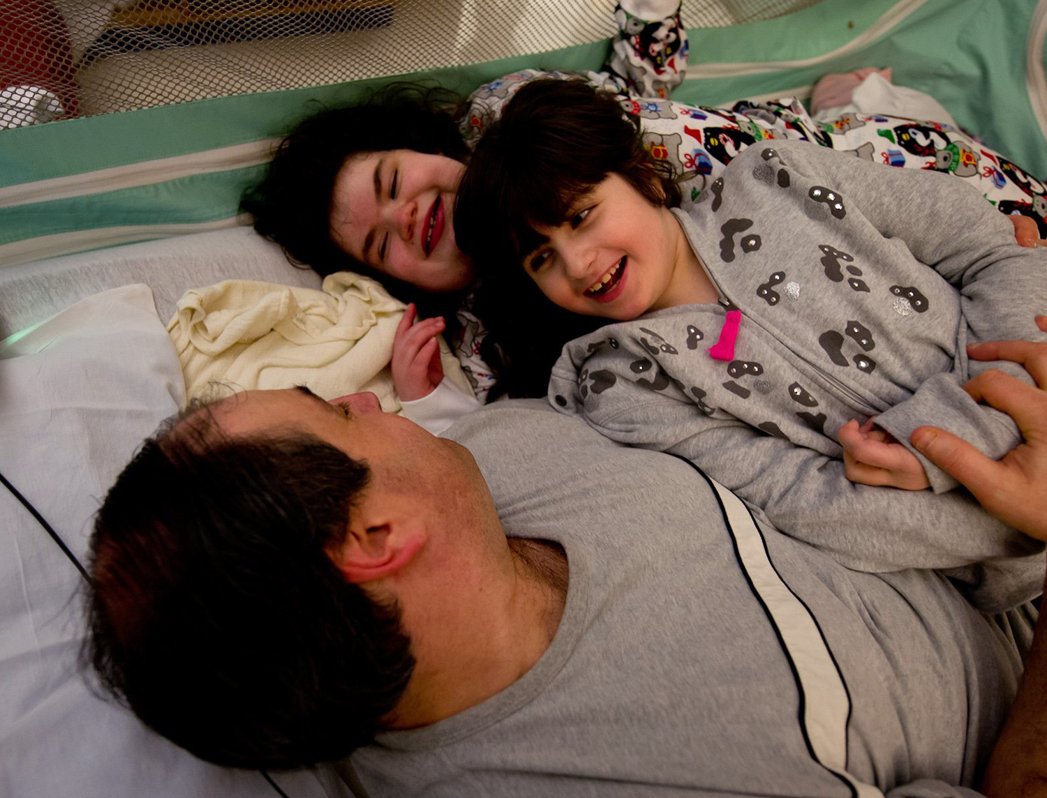 There's no cure for Hayley and Bari Mogul's rare genetic conditions. But physical therapy helps, and so does roughhousing with their dad.