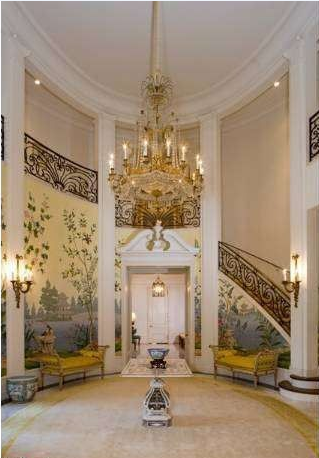 The 10-bedroom Neff estate measures 15,520 square feet and opens to a grand entry with hand-painted wallpaper.