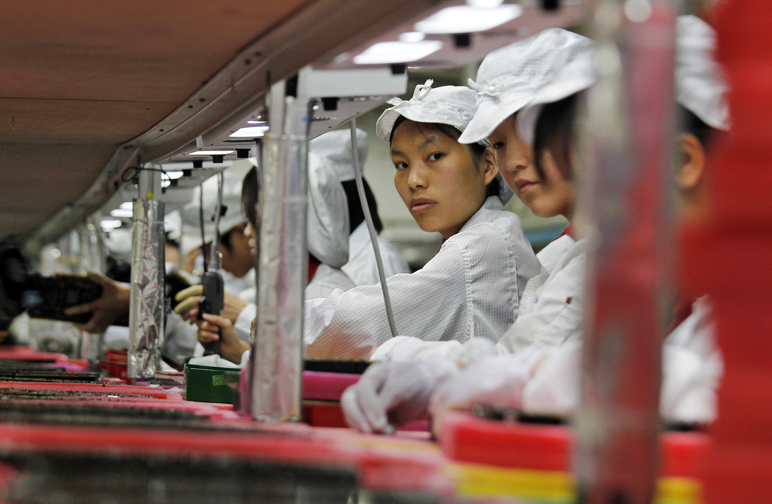Workers are seen inside a Foxconn factory in the township of Longhua in the southern Guangdong province, in this file picture taken May 26, 2010. In a...