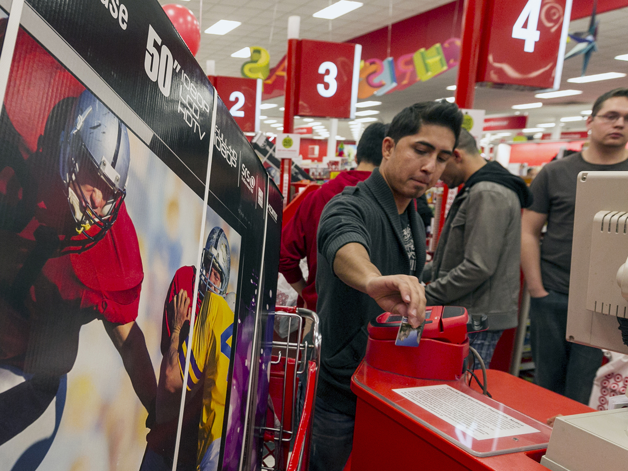 A customer swipes his credit card to pau for a television doorbuster deal at a Target store in Burbank, Calif., on Nov. 22, 2012.
