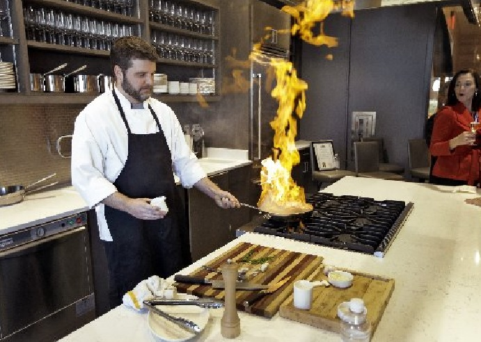 Executive Chef Chad Johnson cooks a steak Dec. 17 during a tour of the new Epicurean Hotel in Tampa, Fla.