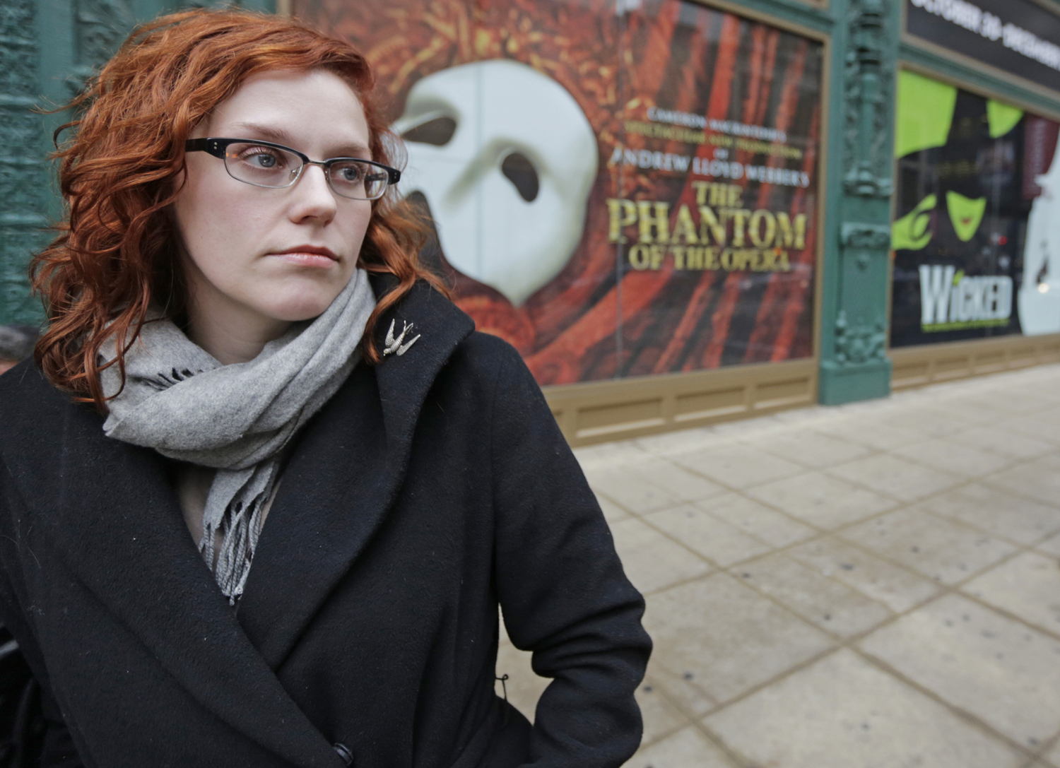 FILE - In this Dec. 3, 2013 file photo, actor Adrienne Matzen poses in Chicago's theater district. Matzen, 29, who has been mostly uninsured since she...