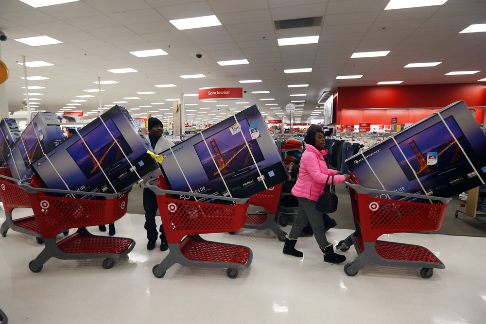 Thanksgiving Day holiday shoppers line up with television sets on discount at the Target retail store in Chicago, Illinois in this November 28, 2013 f...