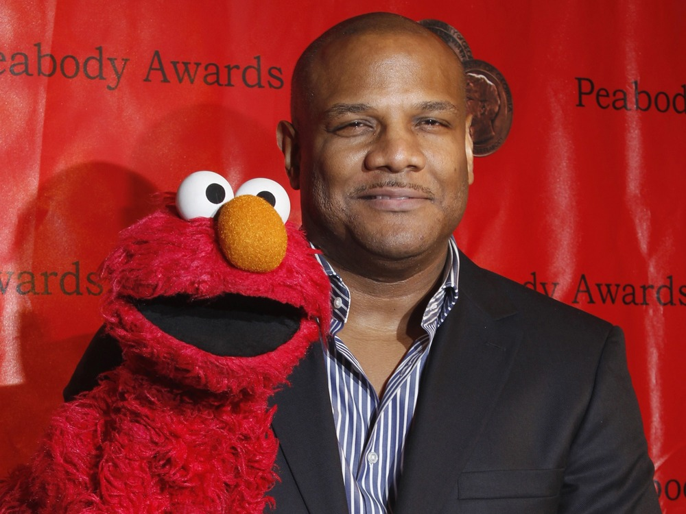 Puppeteer Kevin Clash arrives with Elmo at the Peabody Awards ceremony in 2010.