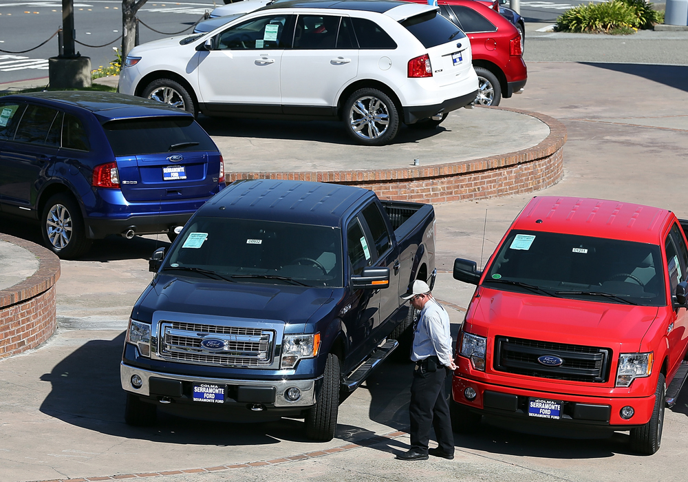 COLMA, CA - MAY 01:  New Ford trucks and cars are displayed on the sales lot at Serramonte Ford on May 1, 2013 in Colma, California.  Ford Motor Co. r...