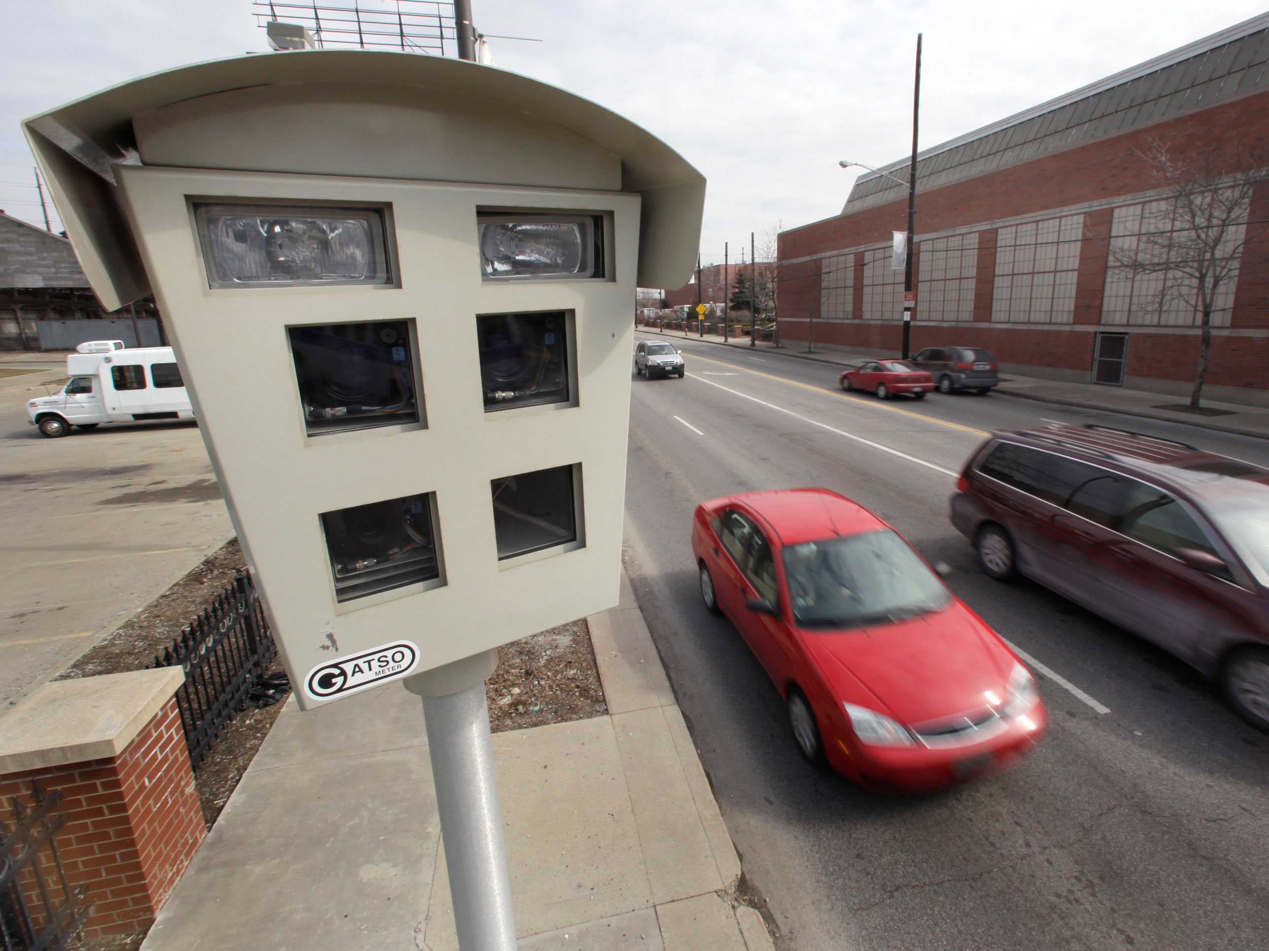 ** ADVANCE FOR SUNDAY, MARCH 22 **Vehicles drive past a speed surveillance and ticketing camera on a road heading into downtown in Cleveland, Ohio on ...
